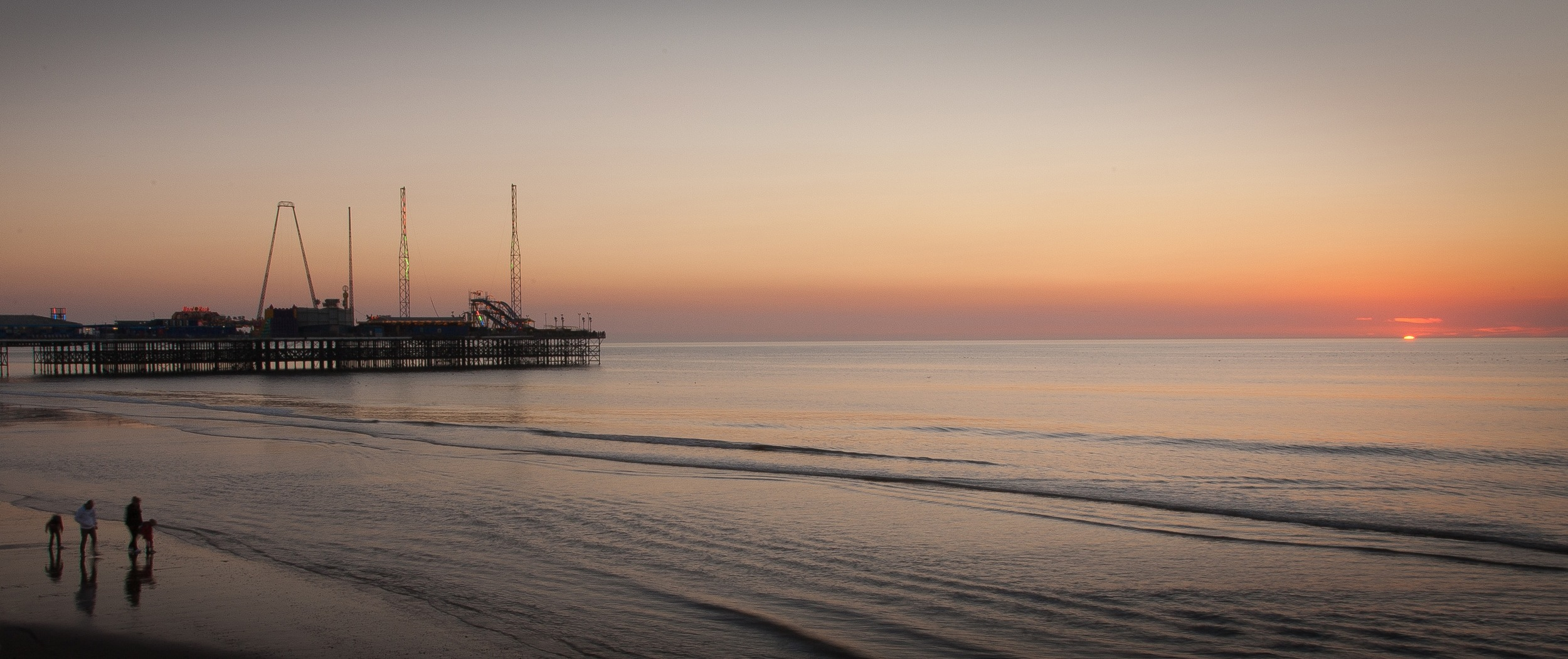 Autumnal sunset near the South Pier at Blackpool
