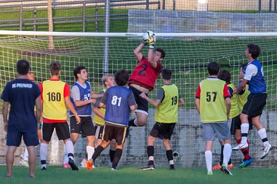 Goalkeeper saves cross at New England soccer camp