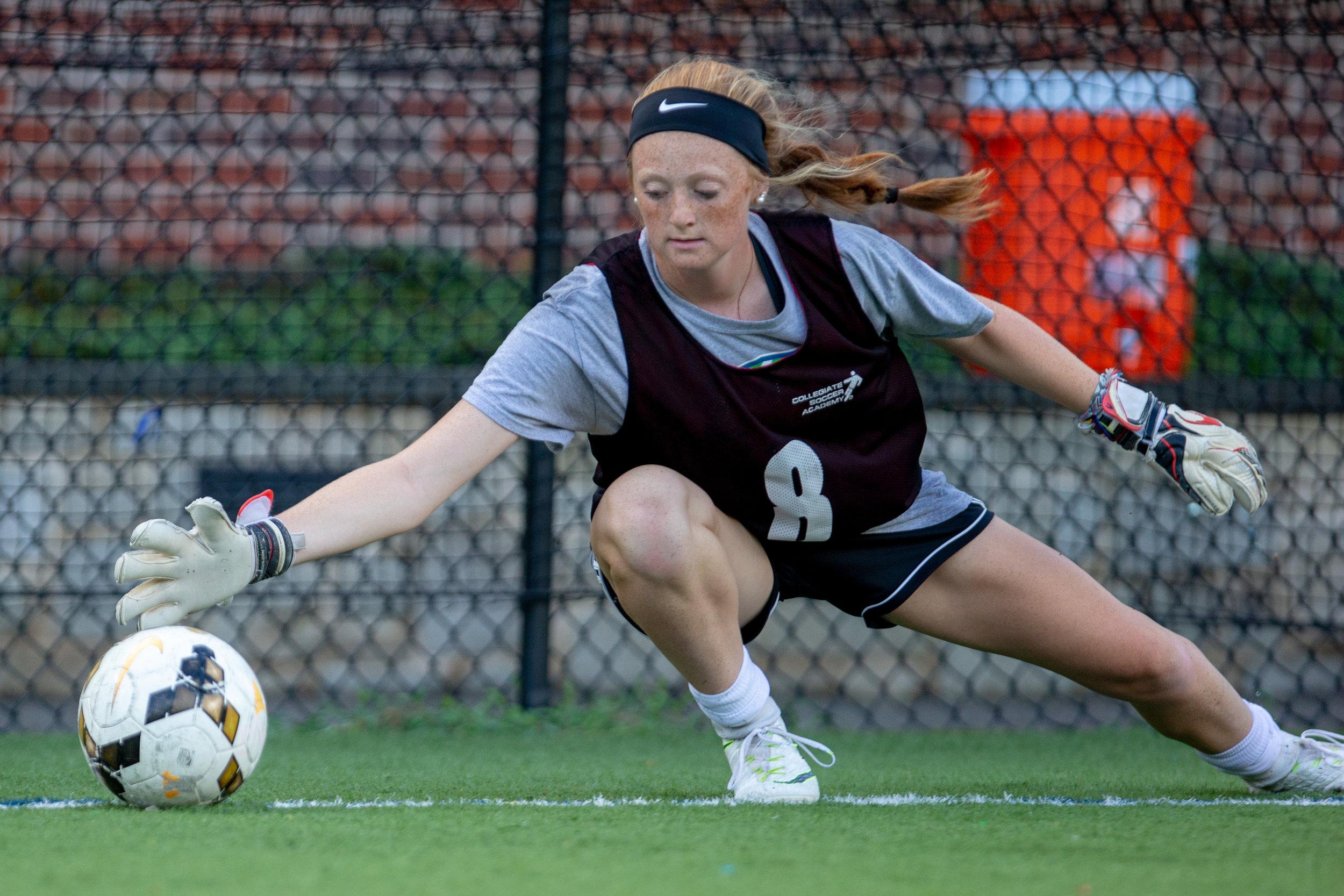 Female saves ball in Newton, Massachusetts