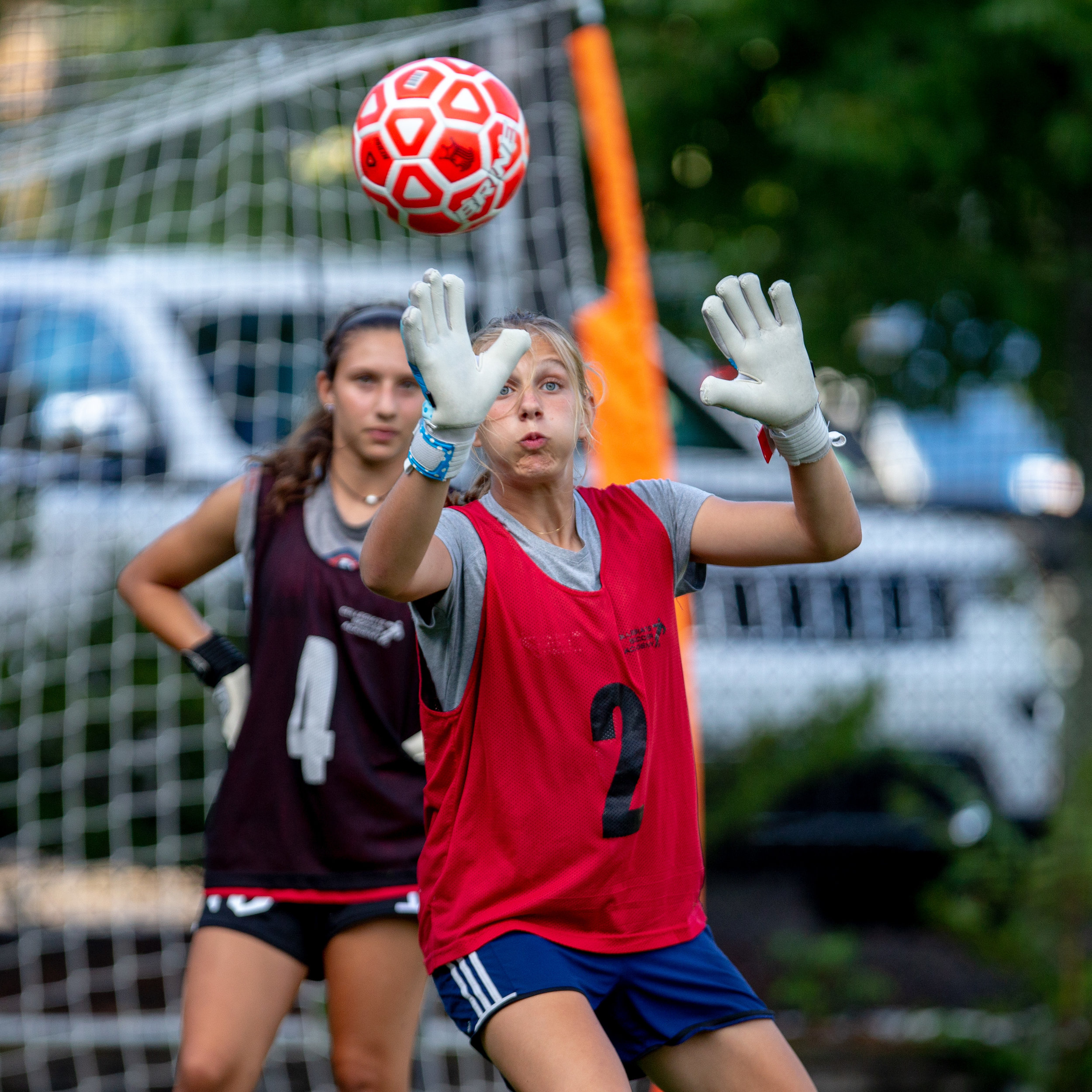Girl takes goalie training with college coach