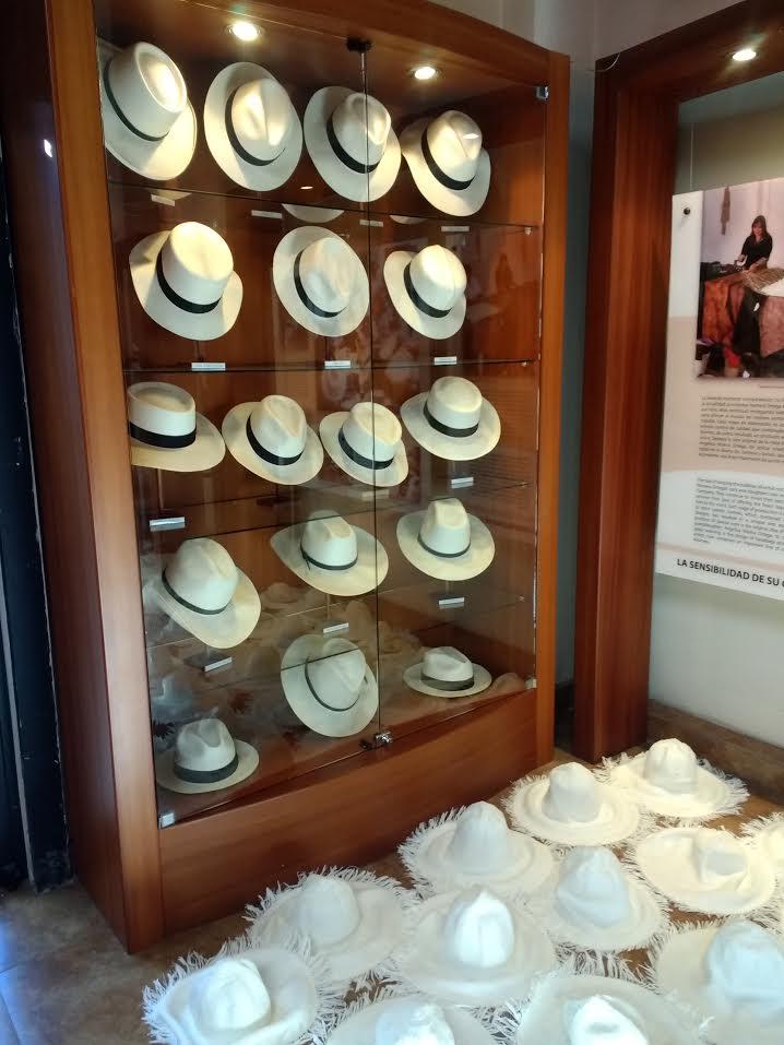 Homero Ortega's showroom with unfinished hats in the foreground.   homeroortega.com