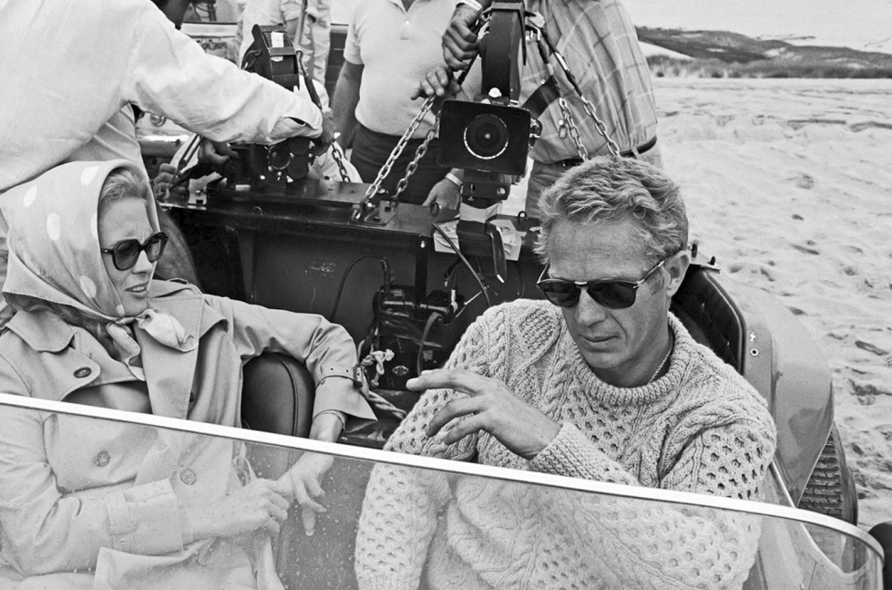 Steve McQueen wearing an Aran sweater on the set of  The Thomas Crown Affair