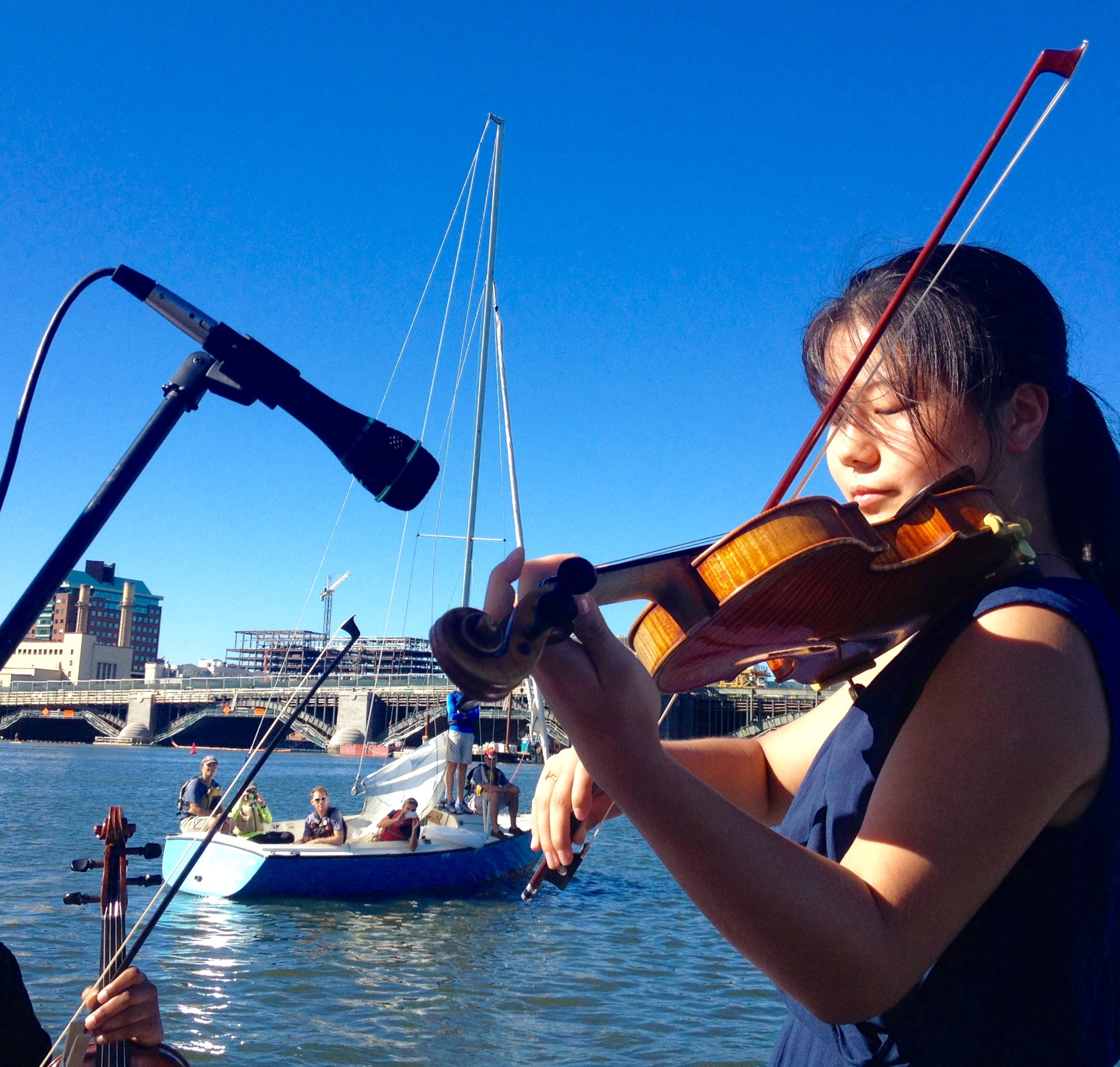 Performing Bach on the Charles, standing on Maestro Zander's boat!