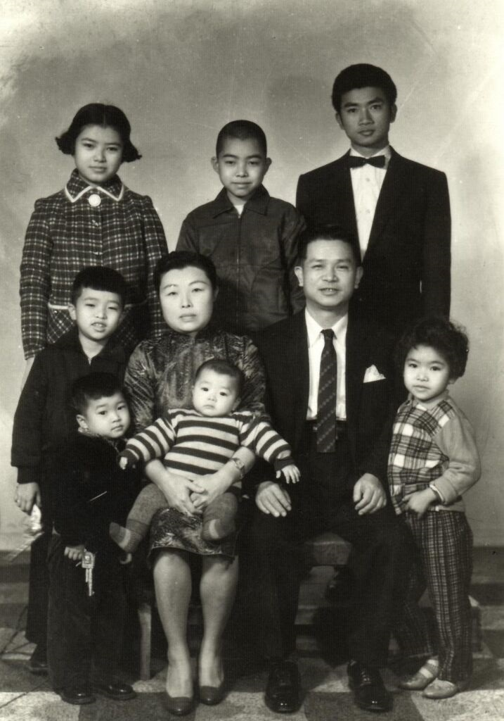 From Yi Yiing Chen: My ah ma and my grandfather sitting with their children standing. My dad is in the front row, the 1st from the left (holding the toy gun!).