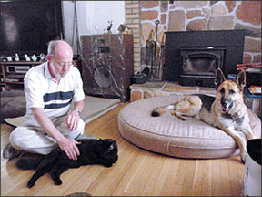 This peaceful scene would have been quite impossible to stage six months ago. Thanks to some very committed owners, two cats and the formerly predatory dog are living together in harmony.  Photo and caption courtesy of  The Whole Dog Journal .