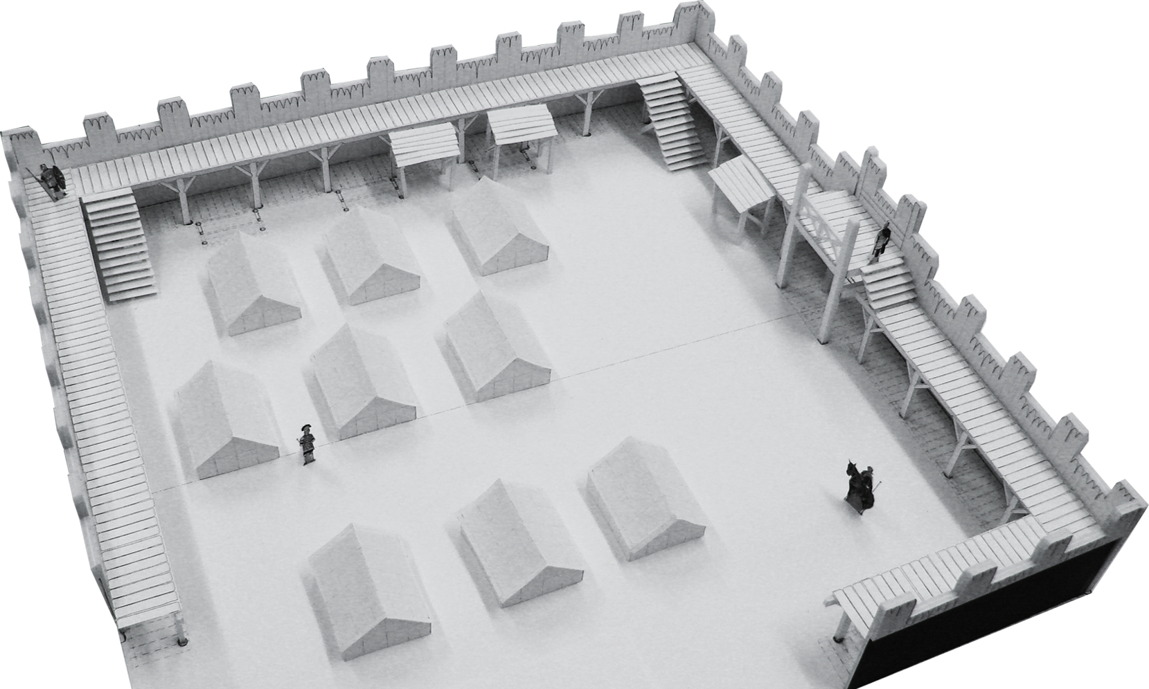 A 1/4 inch scale model of the fort built for the film, used by construction explanation, story boarding and stunt meetings.