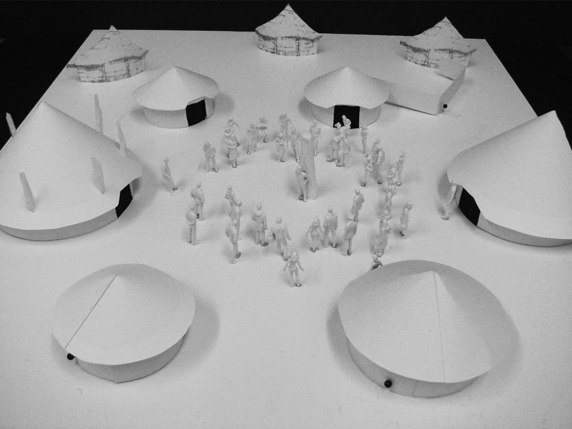 Model showing layout of the round houses along with three cut-out background huts.