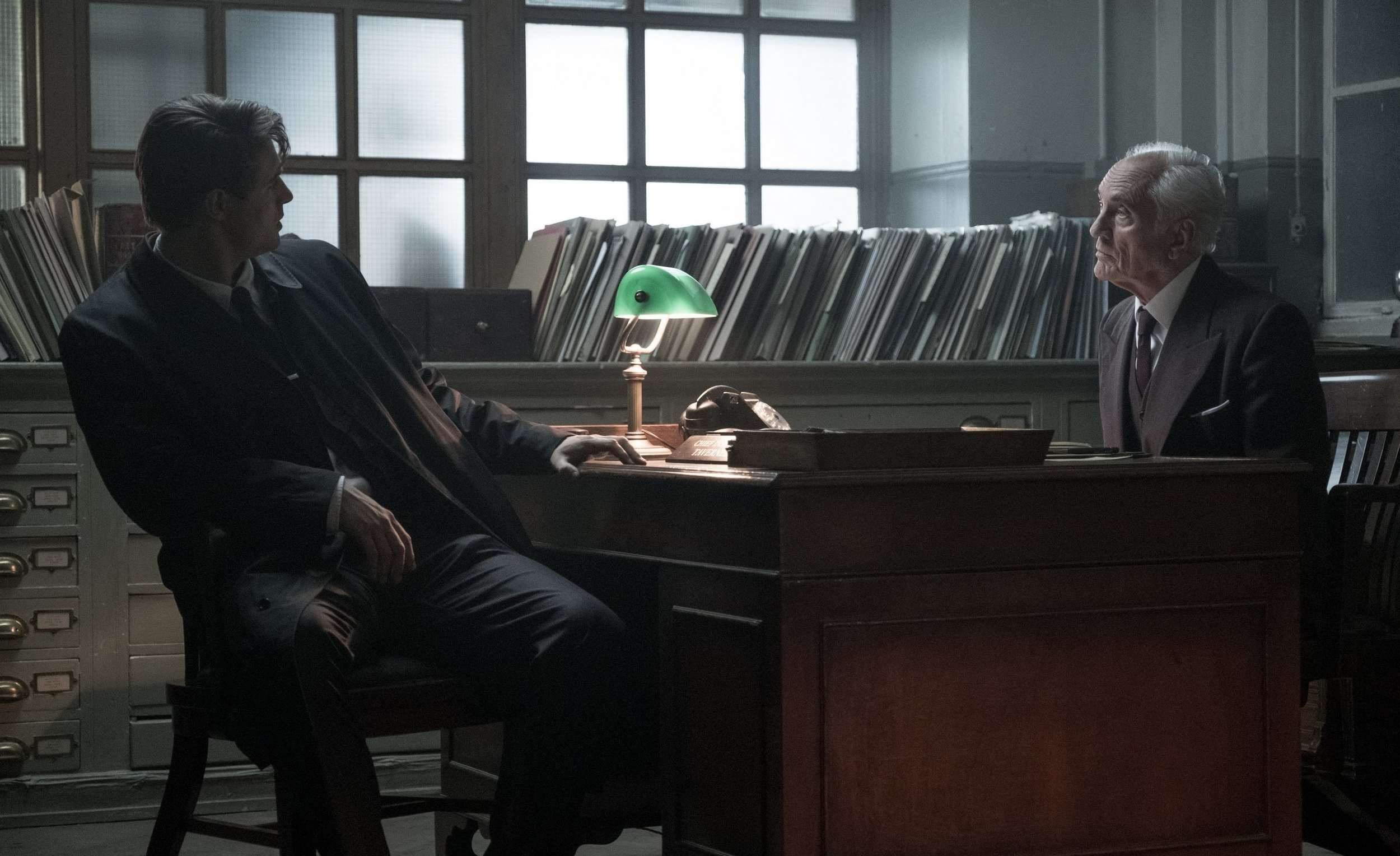Max Irons and Terence Stamp in Inspector Tavener's Office at Scotland Yard.