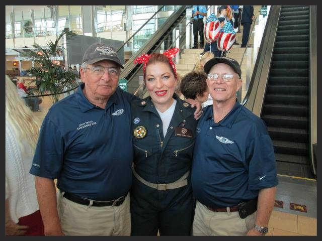 "Col. John Telles (Ret), Rich Kenney, and Air Group One's own ""Rosie the Riveter"" Torri Mowery"