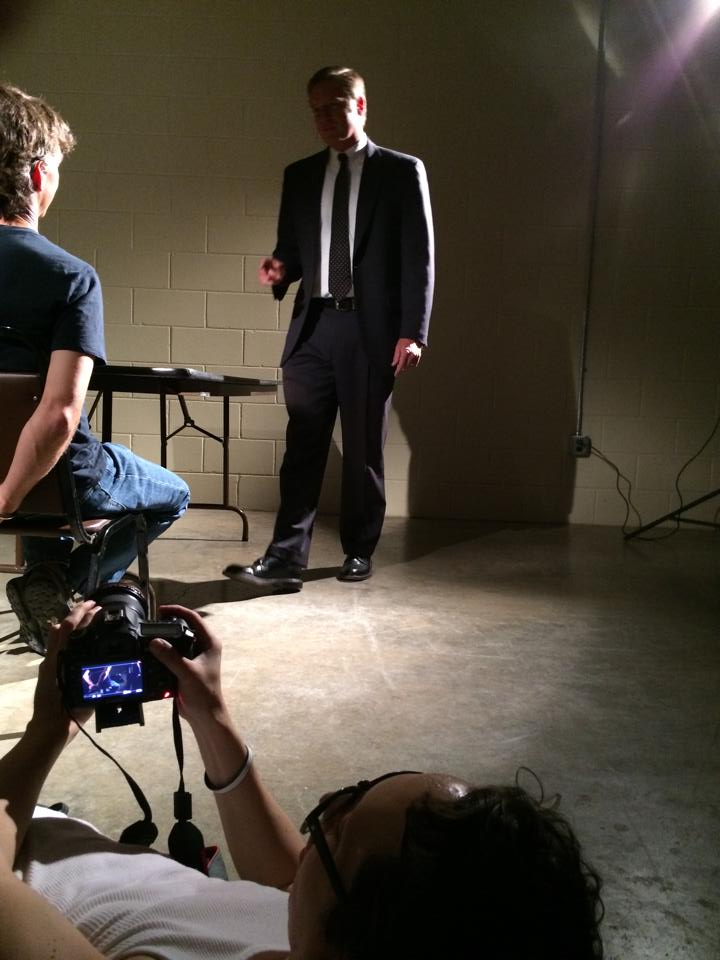 Daniel Lee Perea films a reenactment for I Didn't Do It at the Powerhouse last year. Andy Douglas and Bill Dabney are actors that took part in the filming.