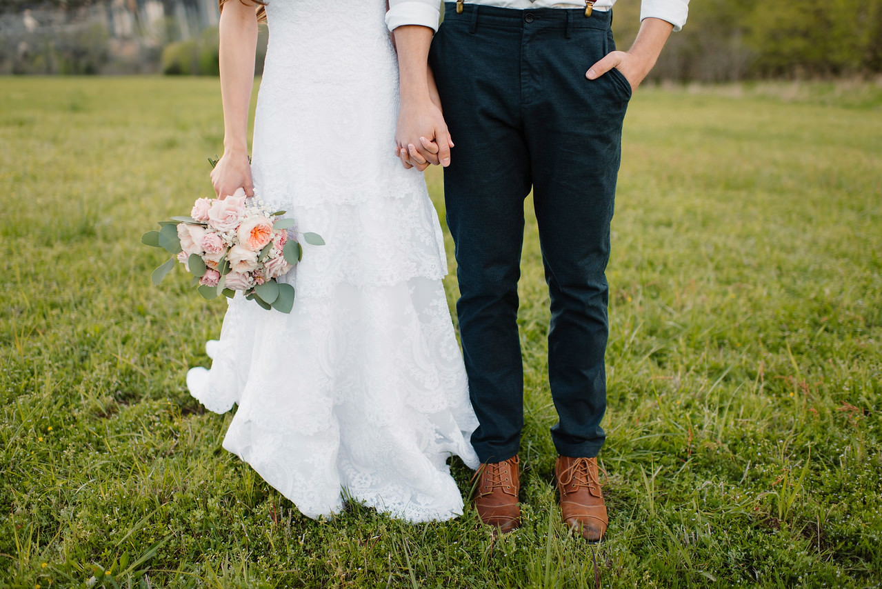 A groom and bride hold hands at Steele Creek after their Buffalo River Wedding by Arkansas Adventure Destination Photographer Colby and Jess