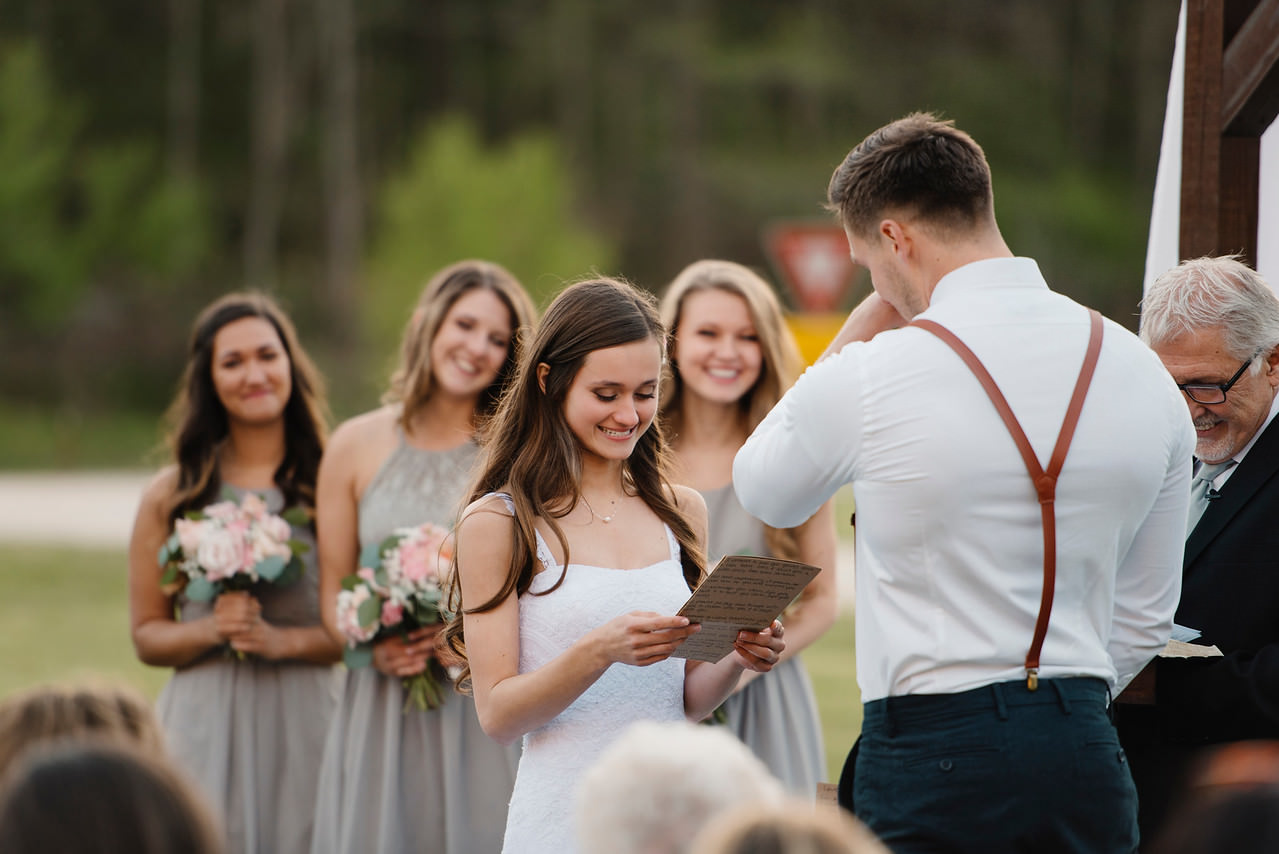 A bride reads her vows during her romantic Buffalo River Wedding with Arkansas Adventure Destination Photographer Colby and Jess