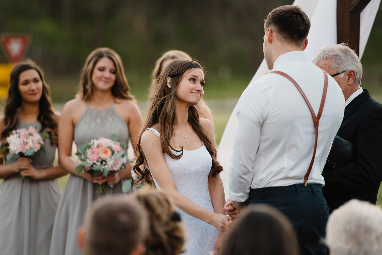 A bride looks lovingly at her groom during their Buffalo River Wedding by Arkansas Adventure Destination Photographer Colby and Jess