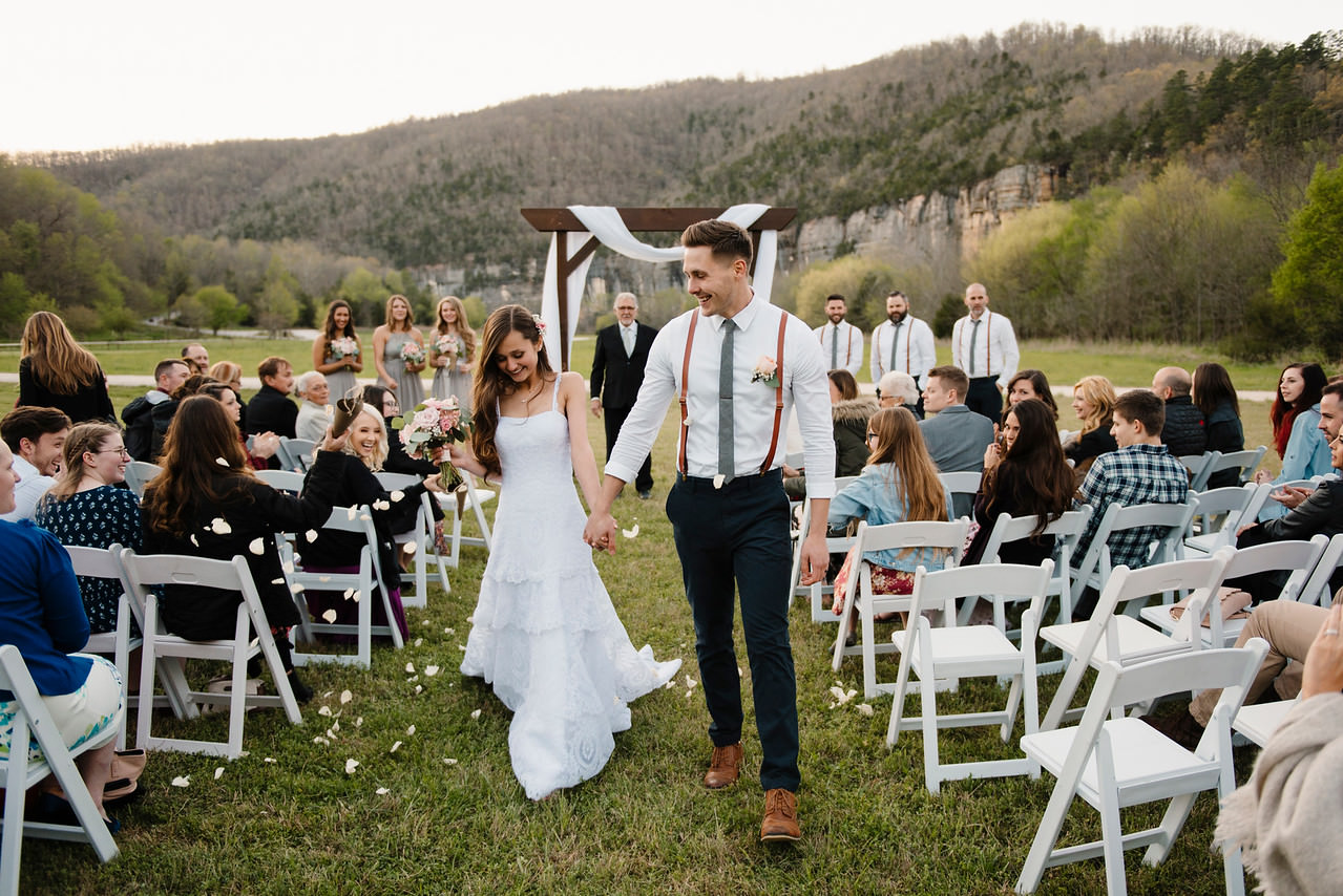 After being pronounced man and wife a couple walks down the aisle during their Buffalo River Wedding with Arkansas Adventure Destination Photographer Colby and Jess
