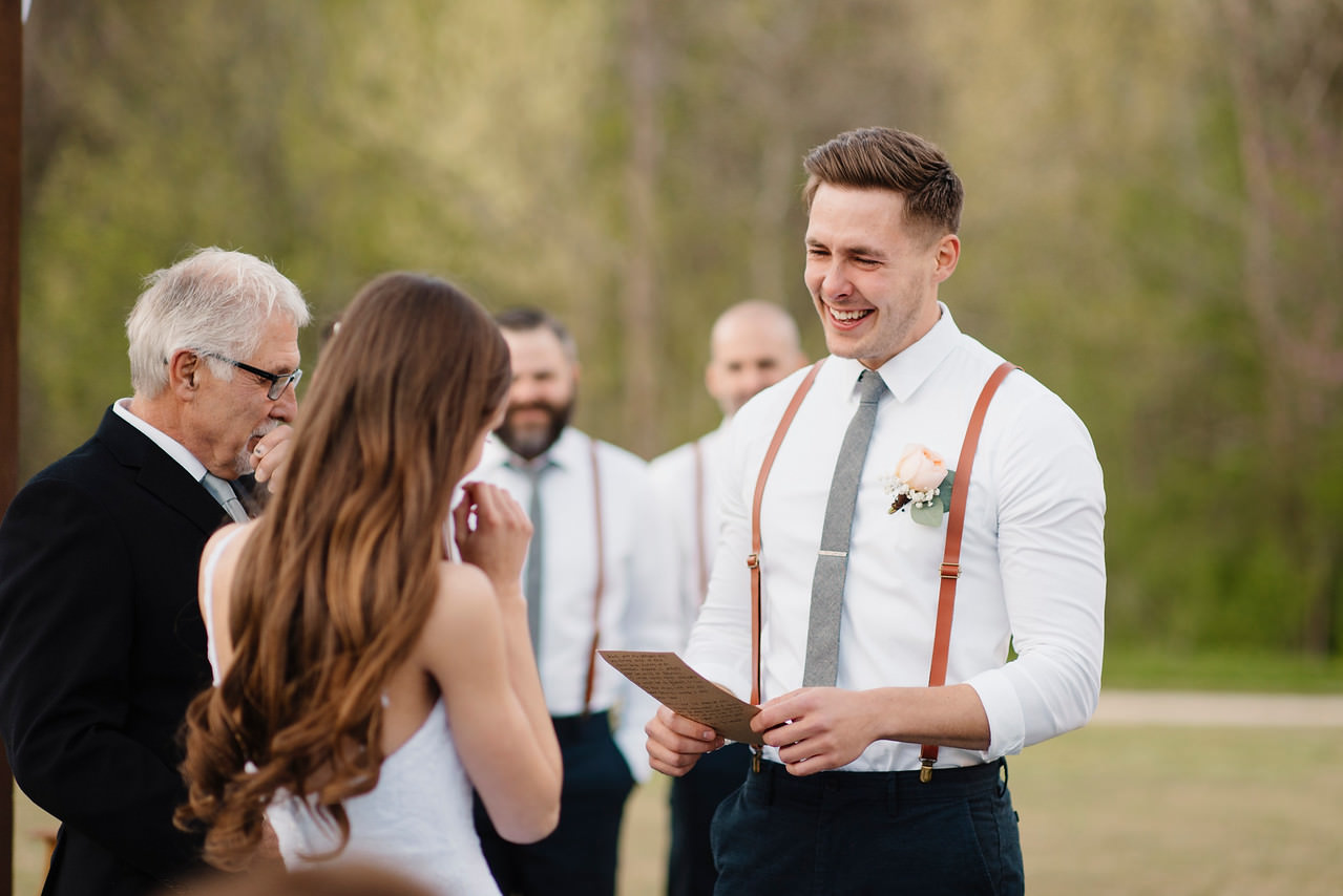 An emotional groom reads his vows to his bride during their Buffalo River Wedding with Arkansas Adventure Destination Photographer Colby and Jess