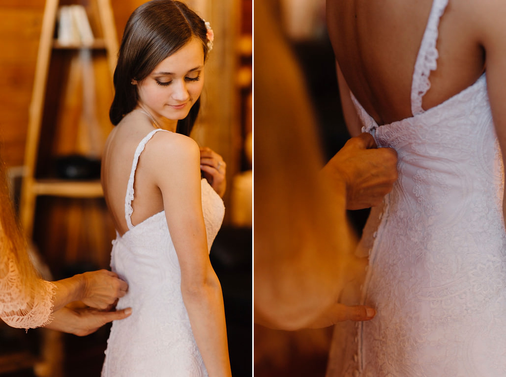 A bride has her dress zipped up in preparation for her Outdoor Buffalo River Wedding by Ozarks Adventure Elopement Photographers Colby and Jess