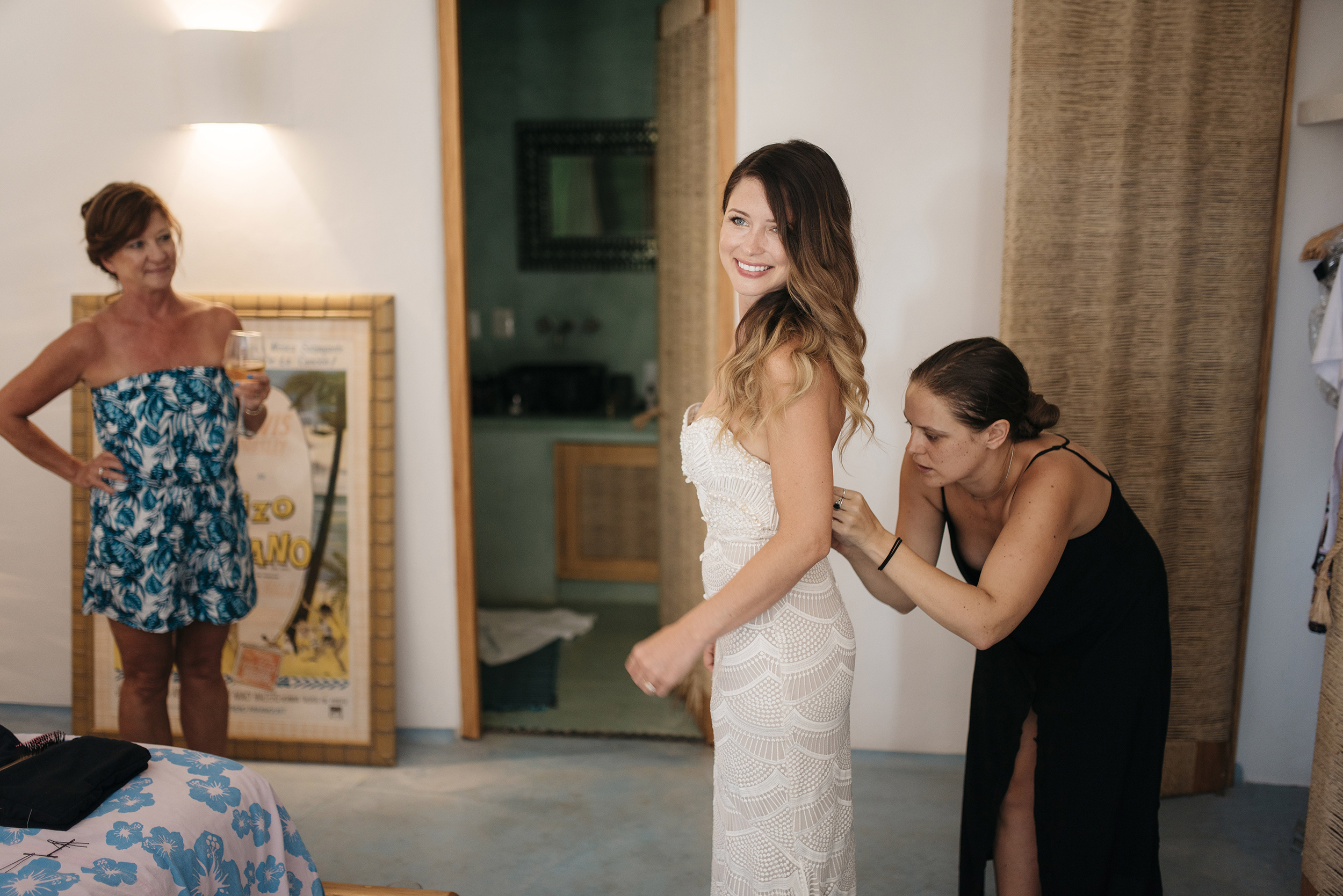Bride gets dressed for Sayulita Beach Wedding photography by Mexico Destination Elopement Photographer Colby and Jess colbyandjess.com