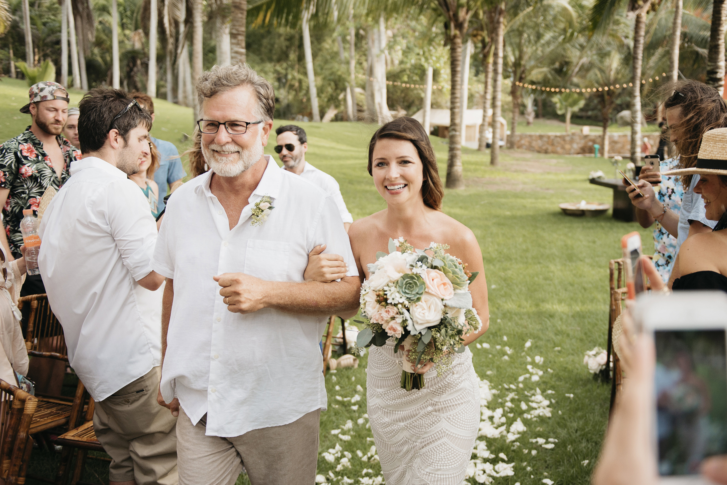 Father walks bride down wedding aisle photography by Sayulita Destination wedding photographers Colby and Jess colbyandjess.com