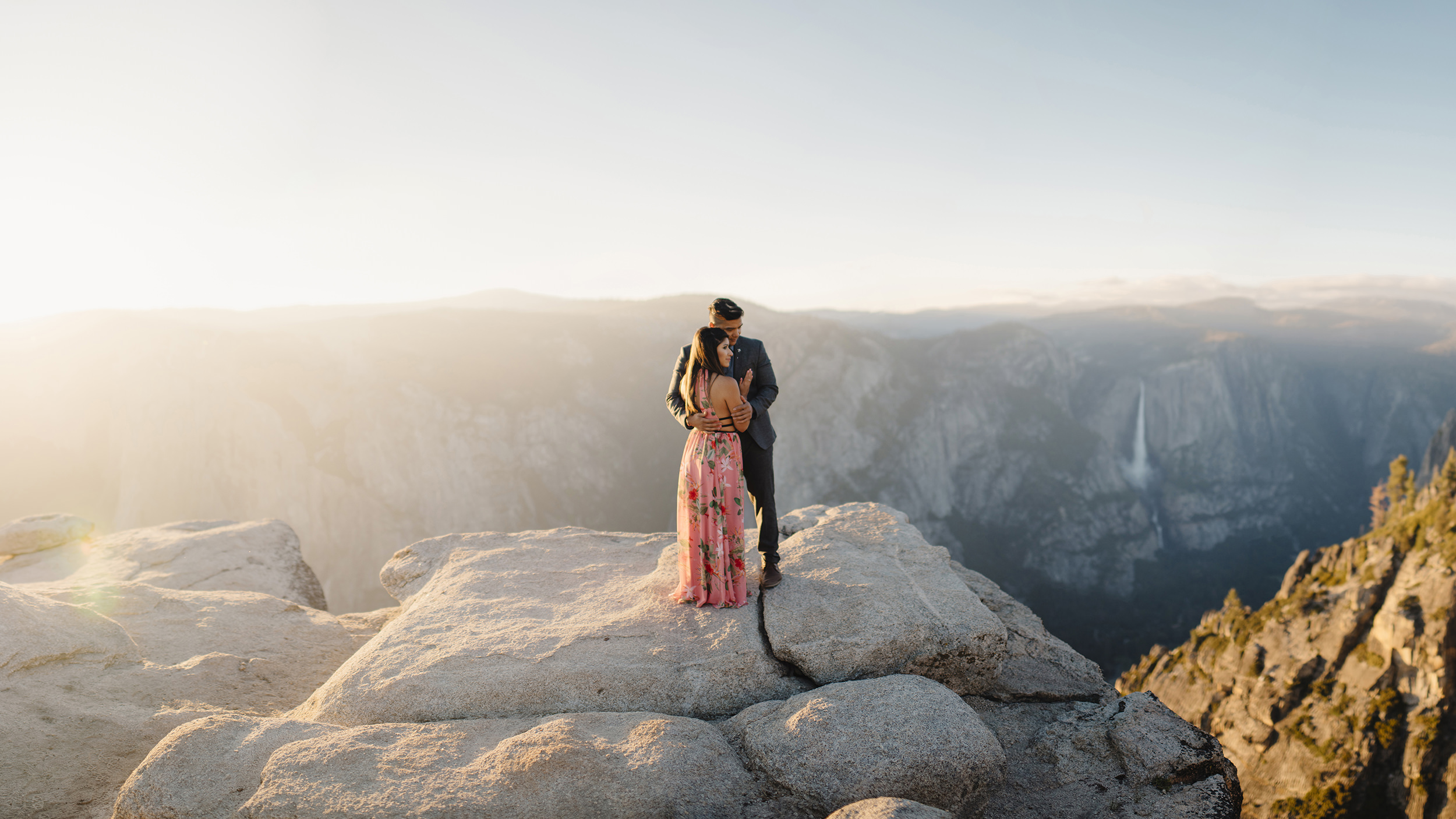 Panoramic view of engaged couple at Taft point during adventure photography session by Yosemite Wedding Photographer Colby and Jess colbyandjess.com