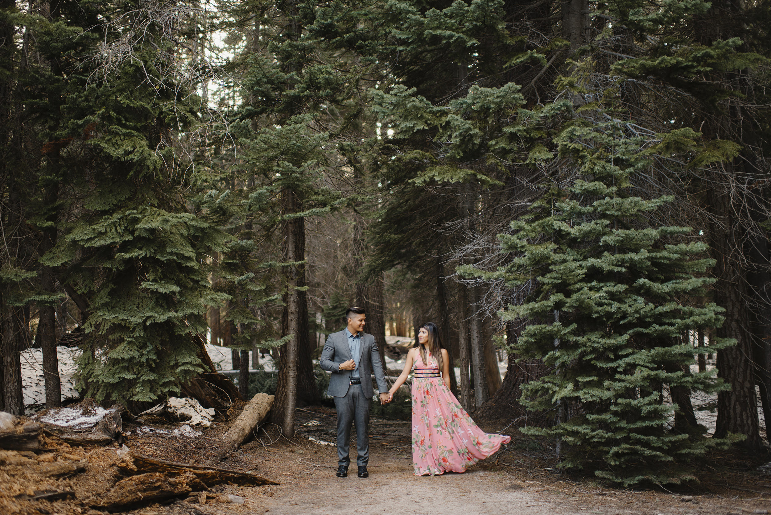 We love how the trail to Taft Point is towered over by tall pine trees. Adventure engagement photos by Yosemite National Park Photographer Colby Moore.  Colby and Jess Photography.  colbyandjess.com