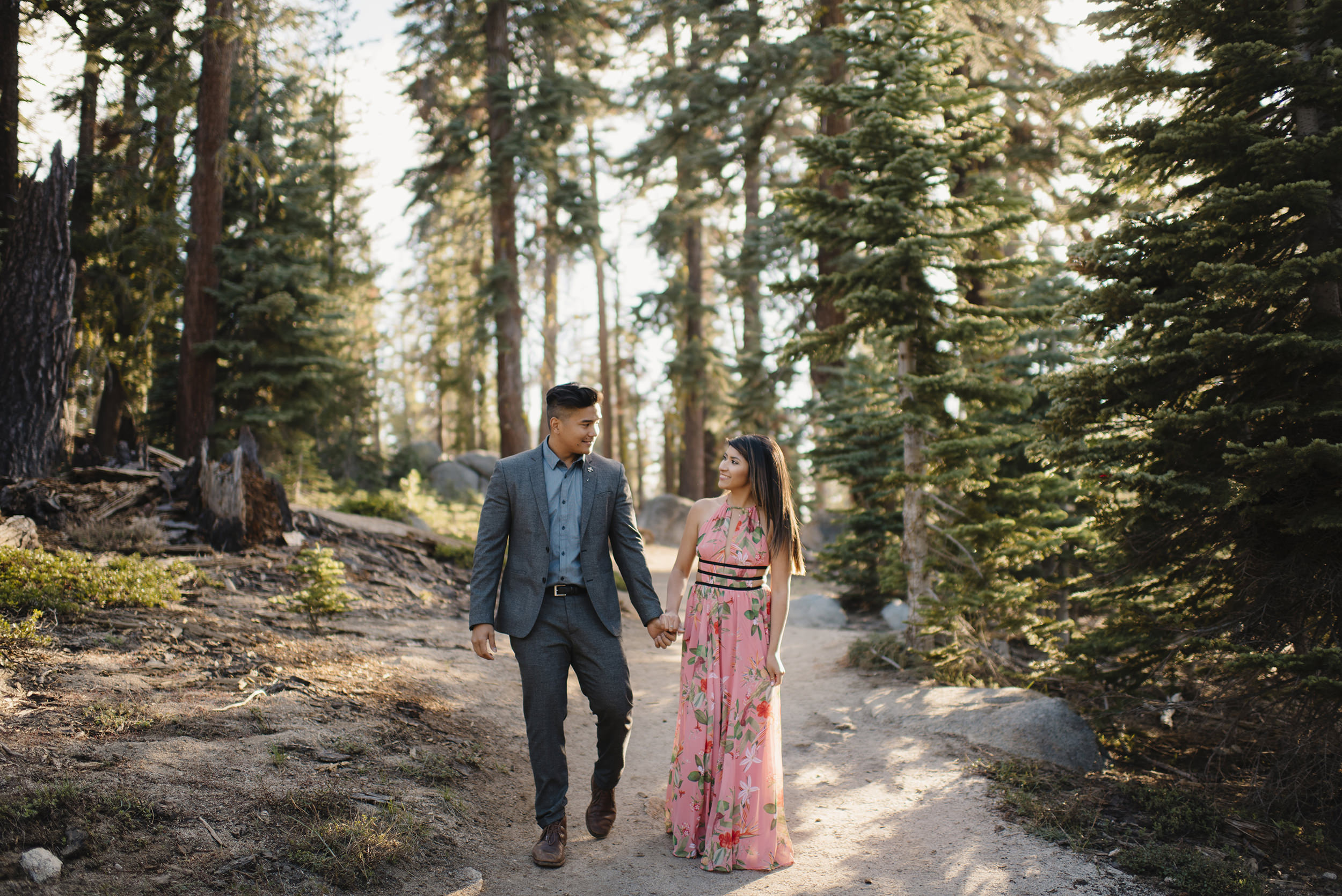 Couple walks holding hands down Taft Point Trail during Engagement Adventure Session by Yosemite Wedding Photographer Colby and Jess.  colbyandjess.com