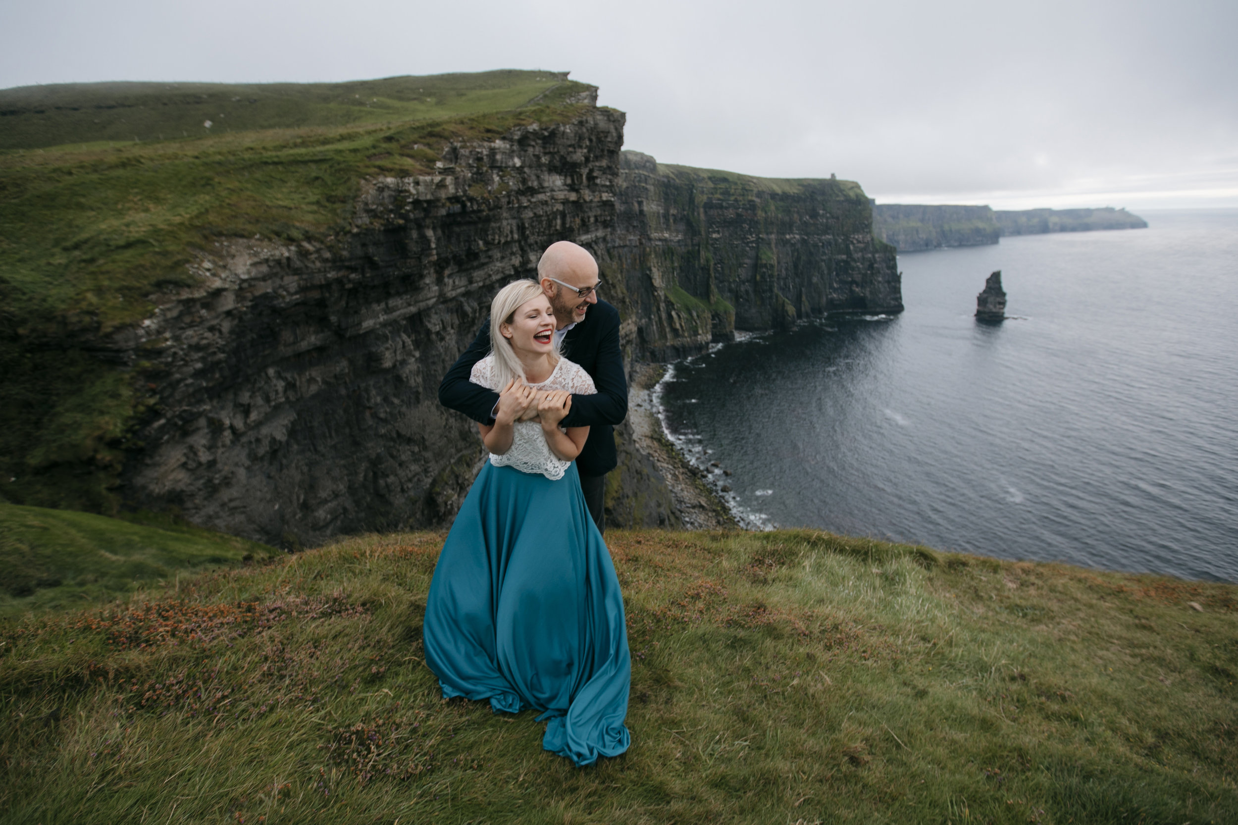 A couple playfully hugging while being photographed by Cliffs of Moher Elopement Photographer Colby and Jess