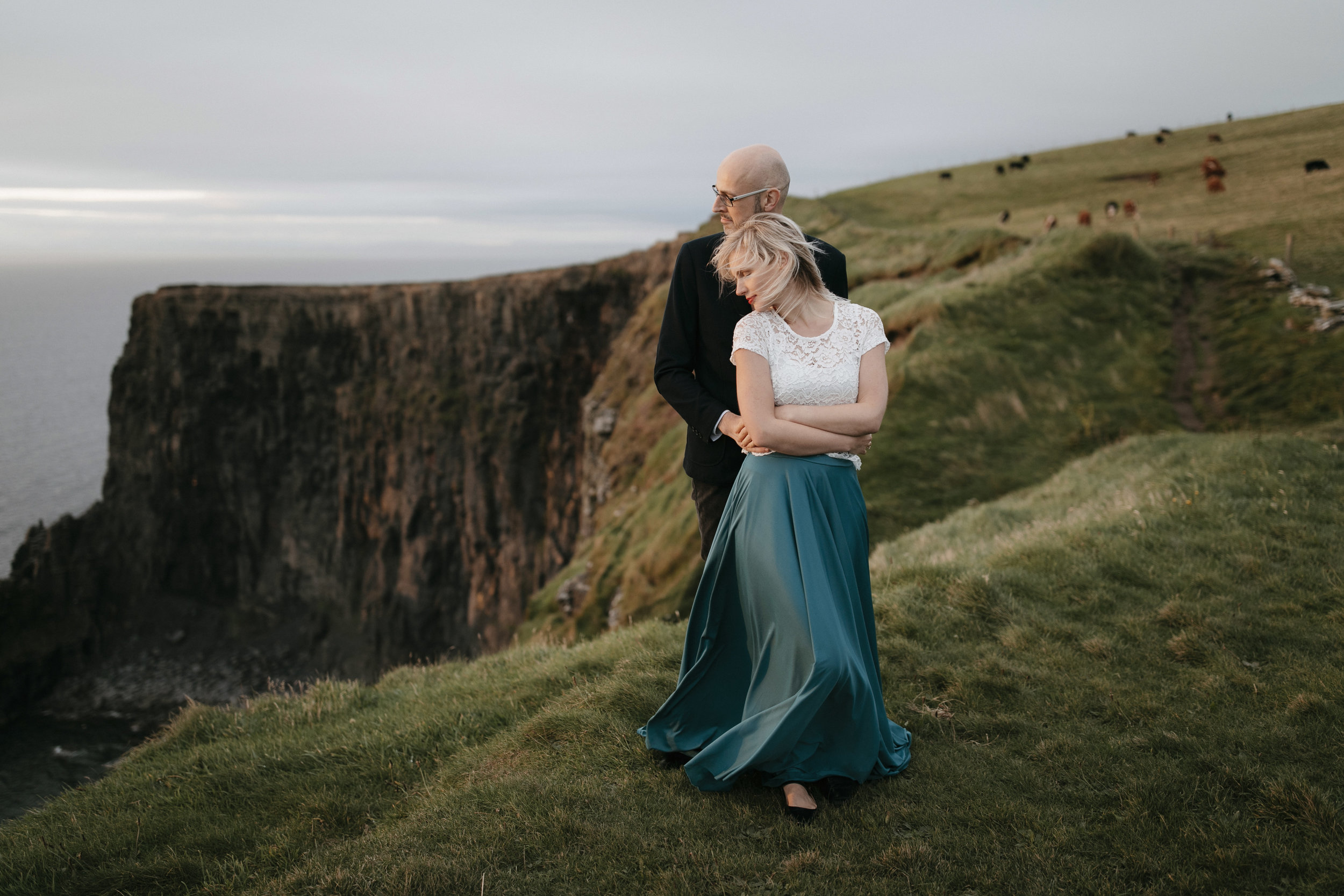 Romantic adventure engagement photography session at Cliffs of Moher by adventure elopement photographer colby and jess