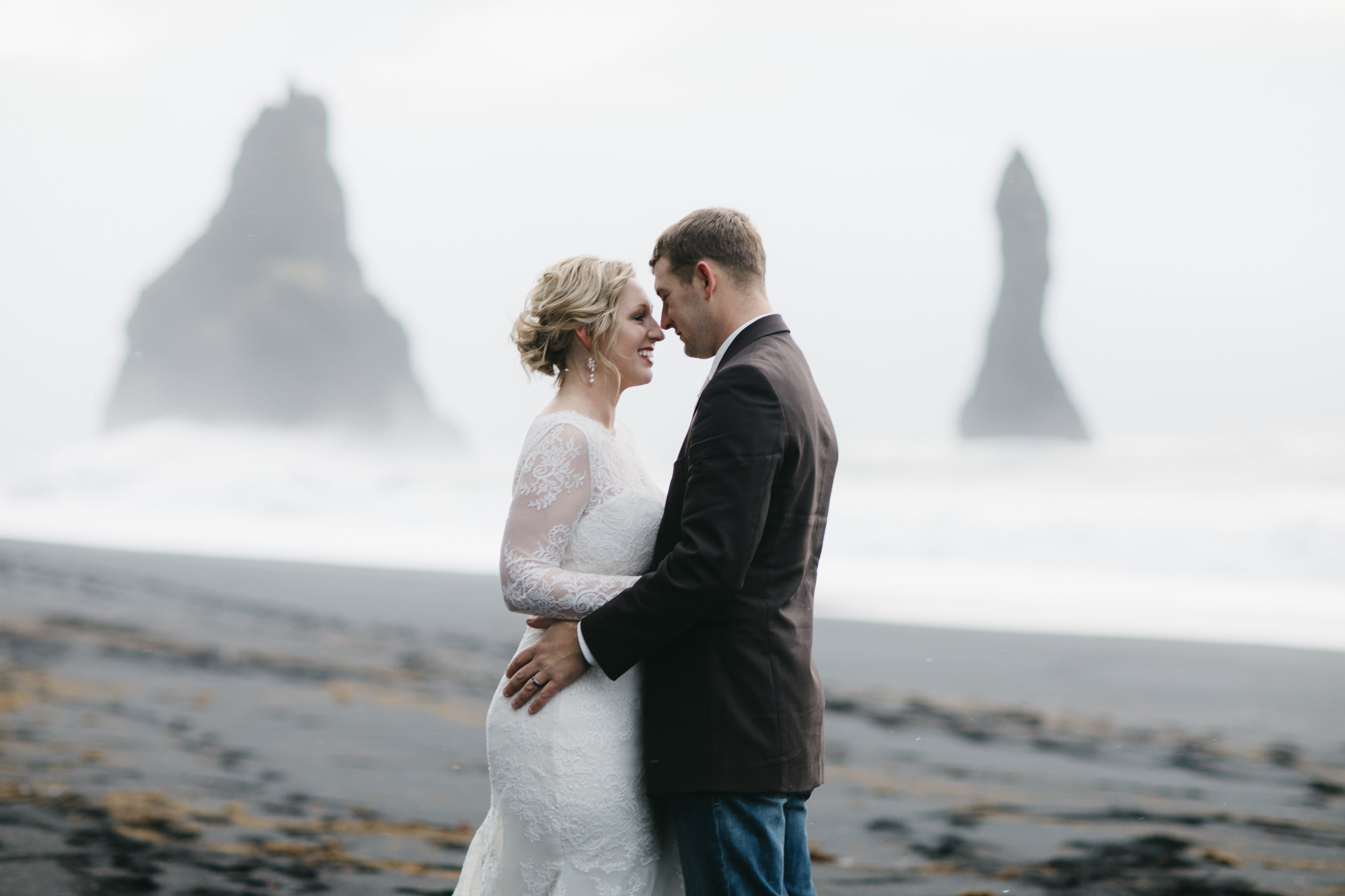 A couple look into each other's eyes during their Black Sand Beach Elopement in Vik Iceland by wedding photographers Colby and Jess, colbyandjess.com
