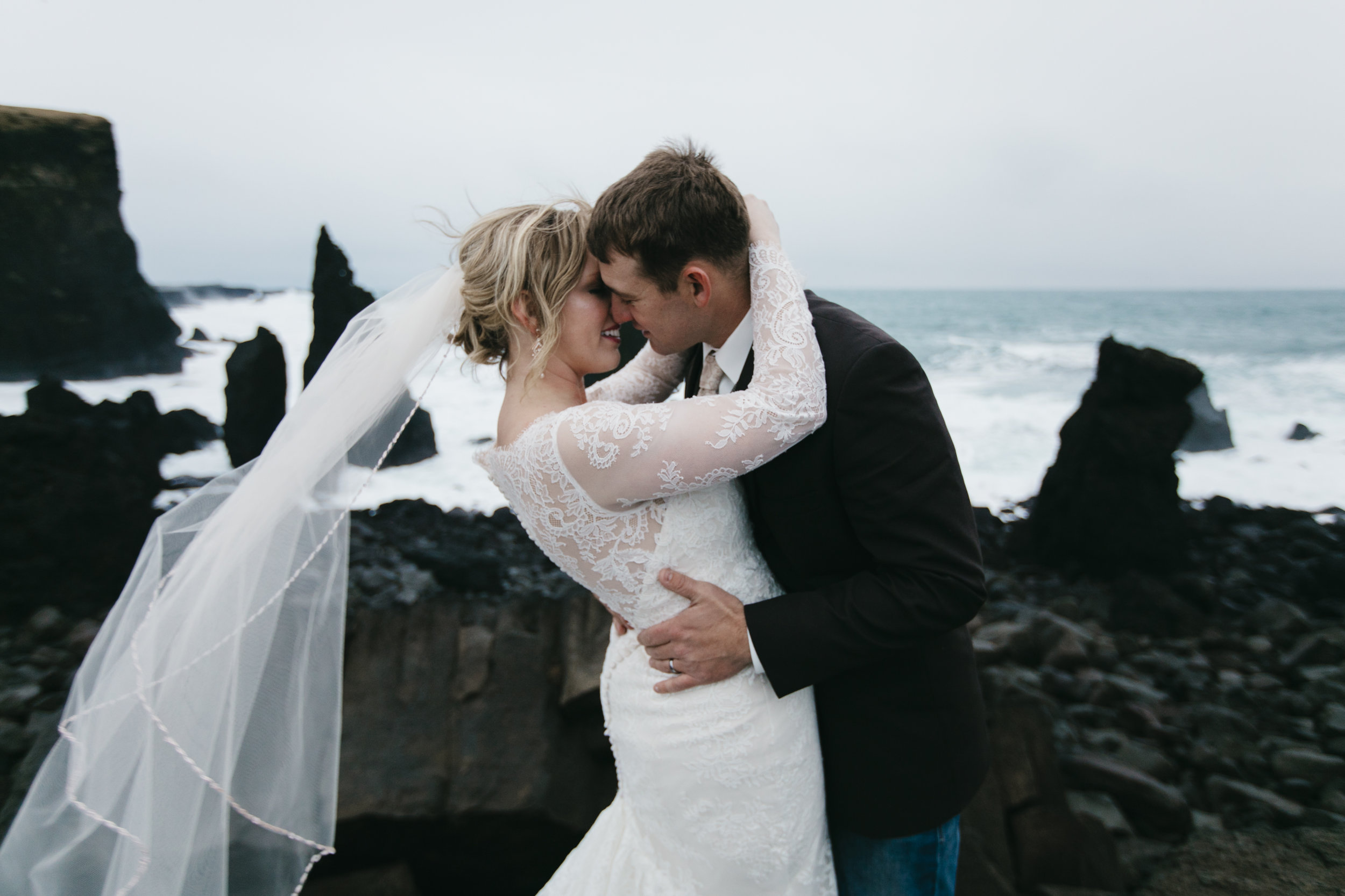 A couple seals their marriage with a kiss during their Iceland Destination Elopement Photography Session.