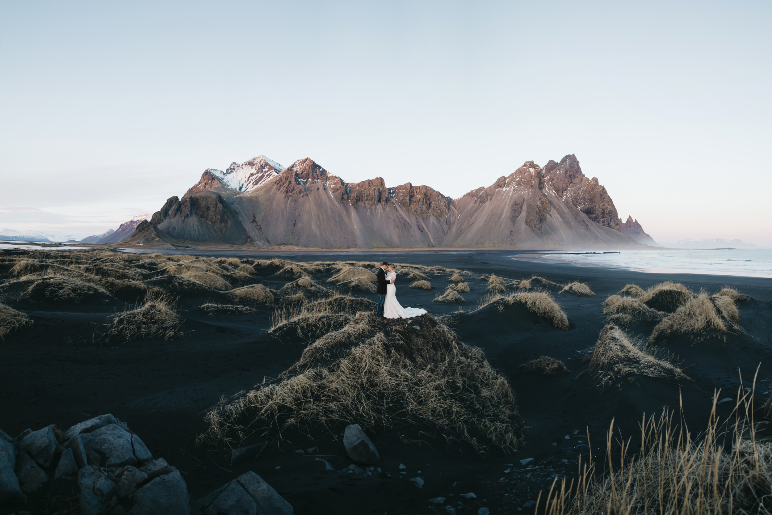 Vestrahorn is the backdrop for a beautiful couple's Iceland Elopement with Iceland Adventure Destination Wedding Photographers Colby and Jess.