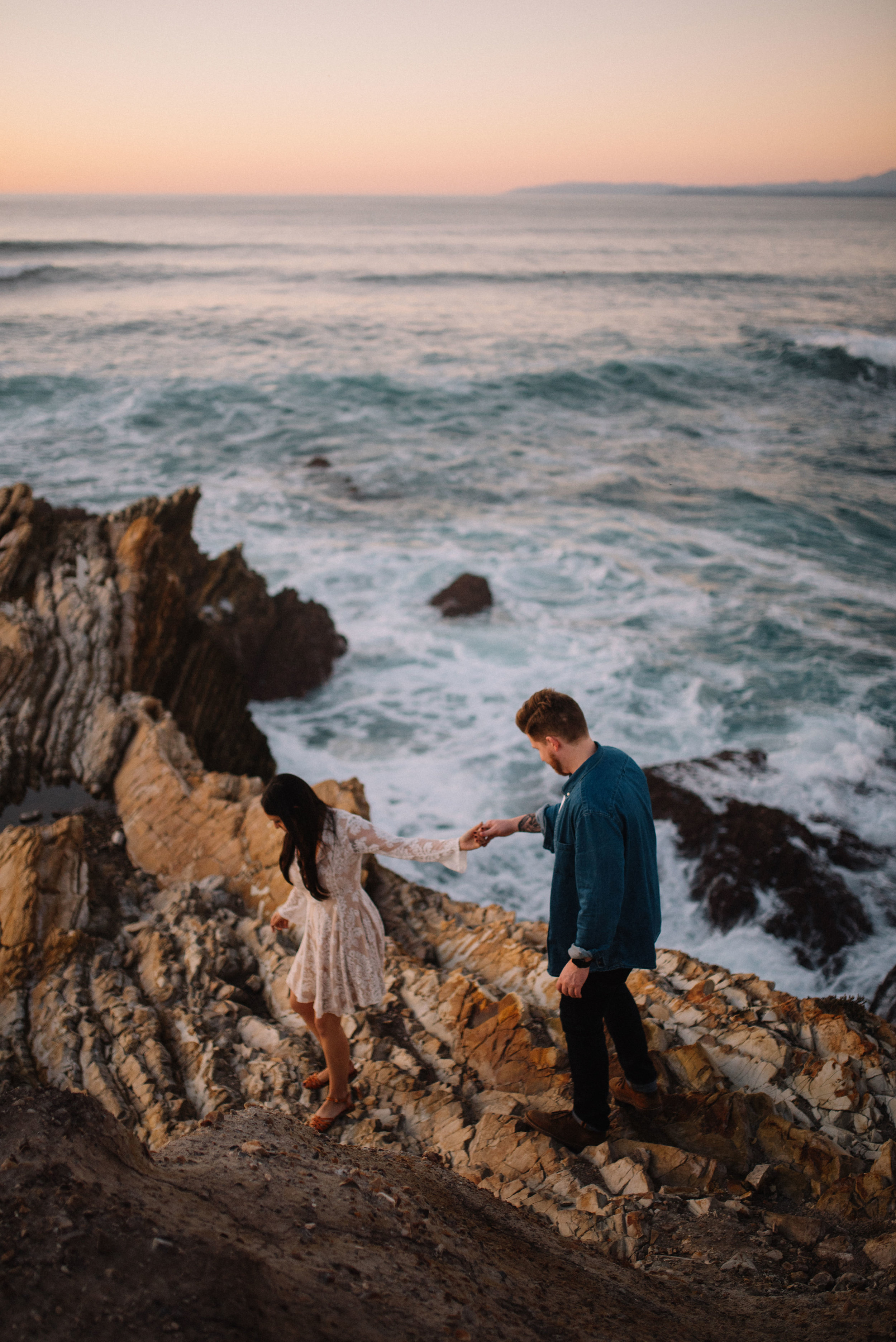 An couple holds hands during their adventurous elopement with Big sur destination wedding photographers colby and jess.