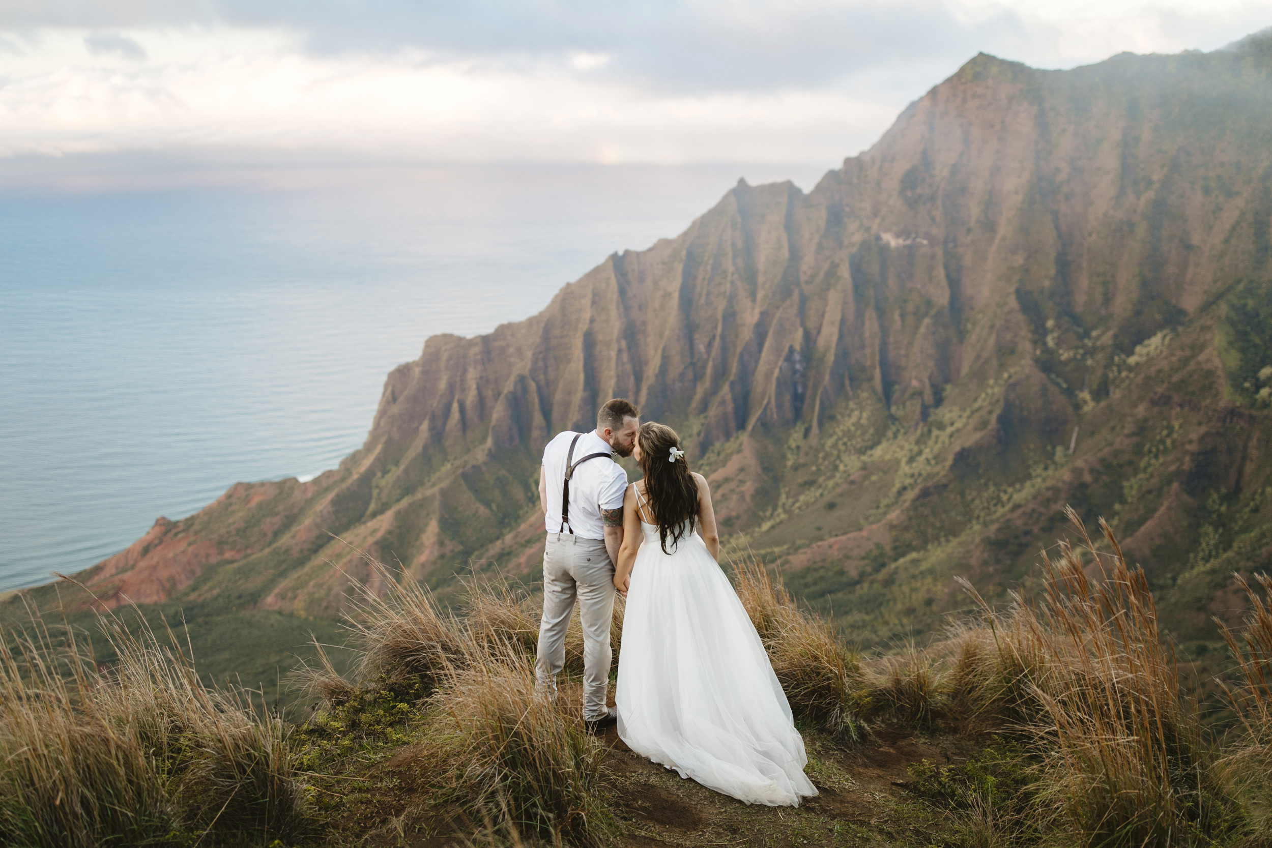 Kalepa ridge wedding ceremony with Kauai elopement photographers Colby and Jess