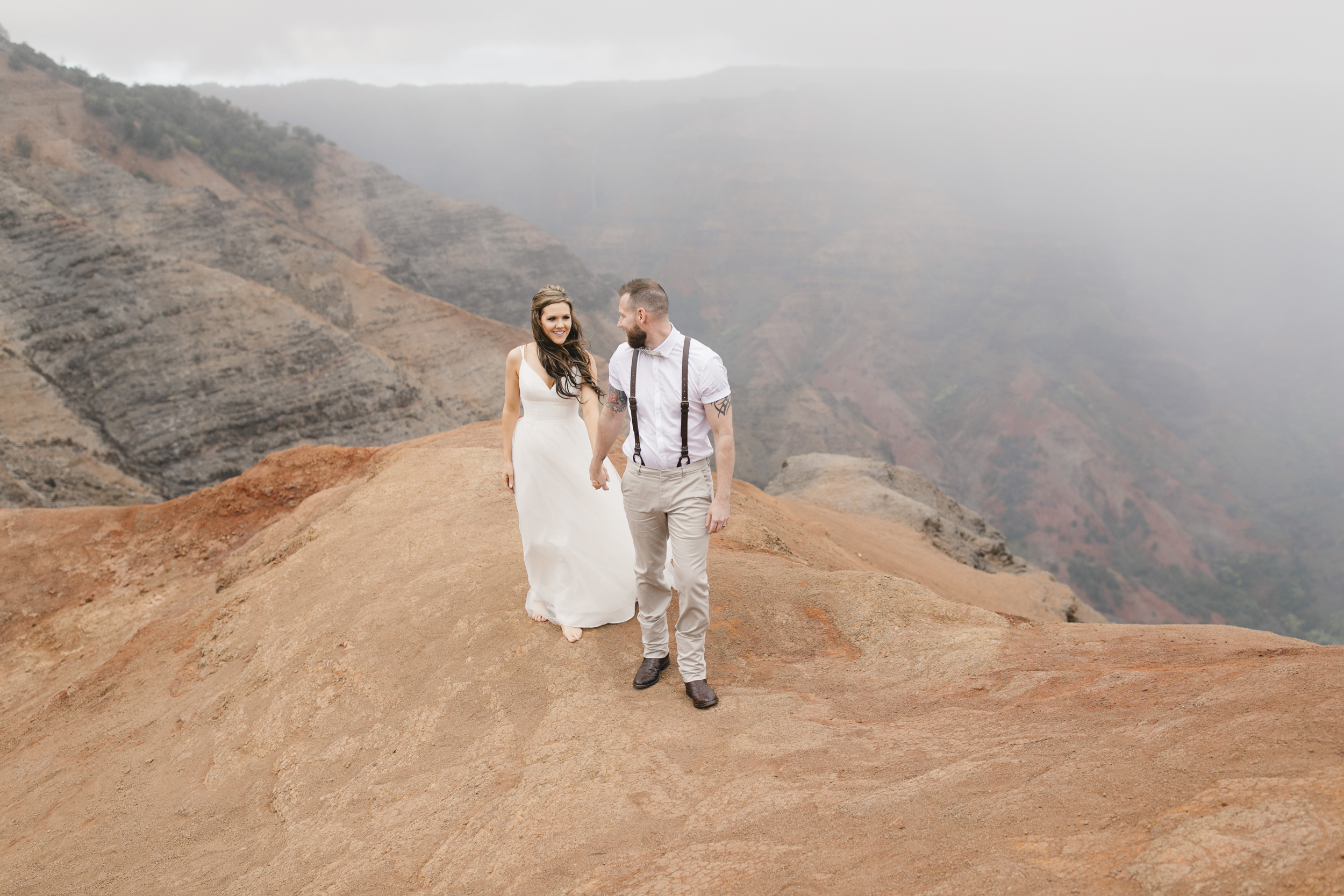 Waimea Canyon wedding ceremony with Kauai elopement photographers Colby and Jess