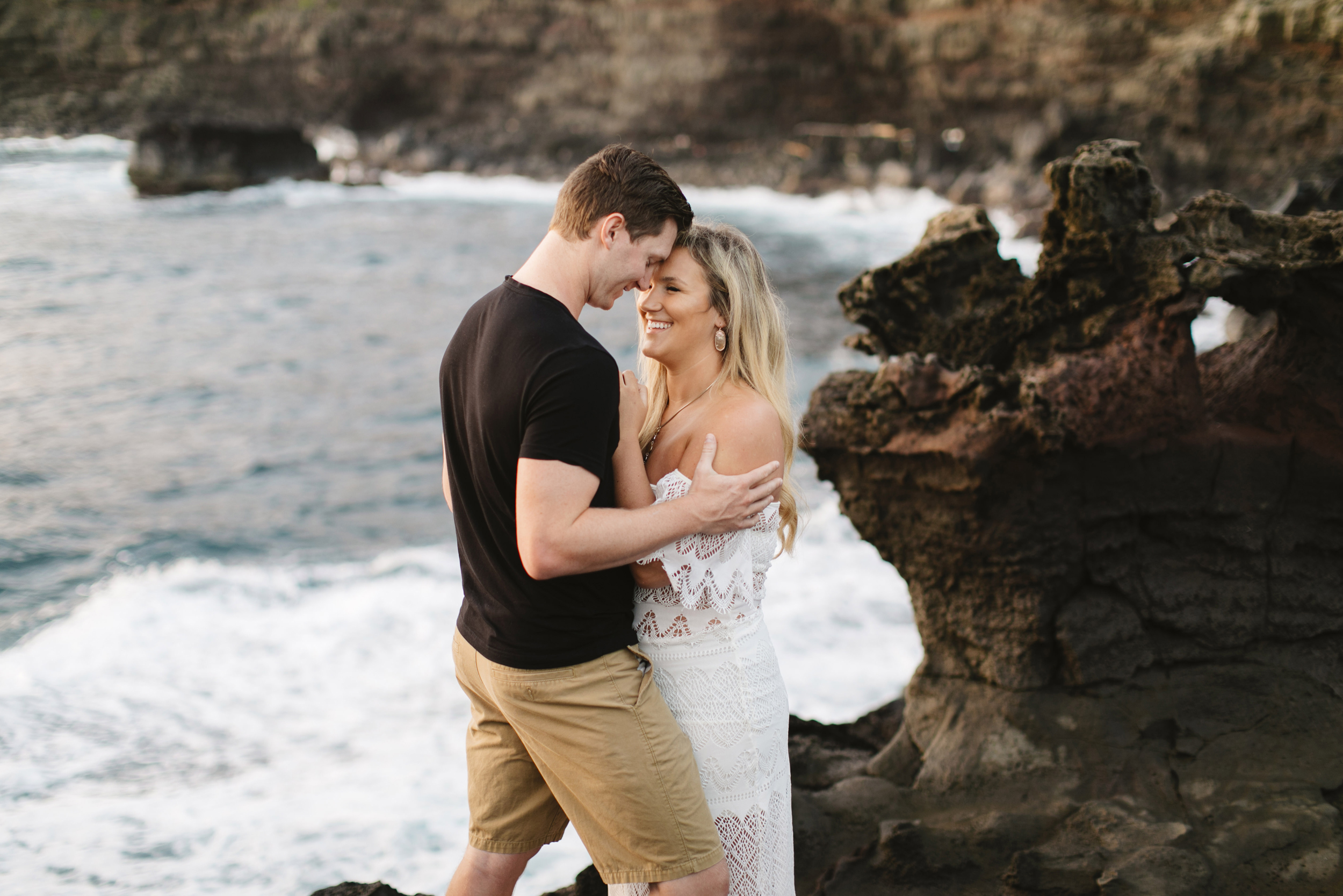 A man and his fiance snuggle during their Maui Adventure Engagement Photography Session by Hawaii Elopement Photographer Colby and Jess