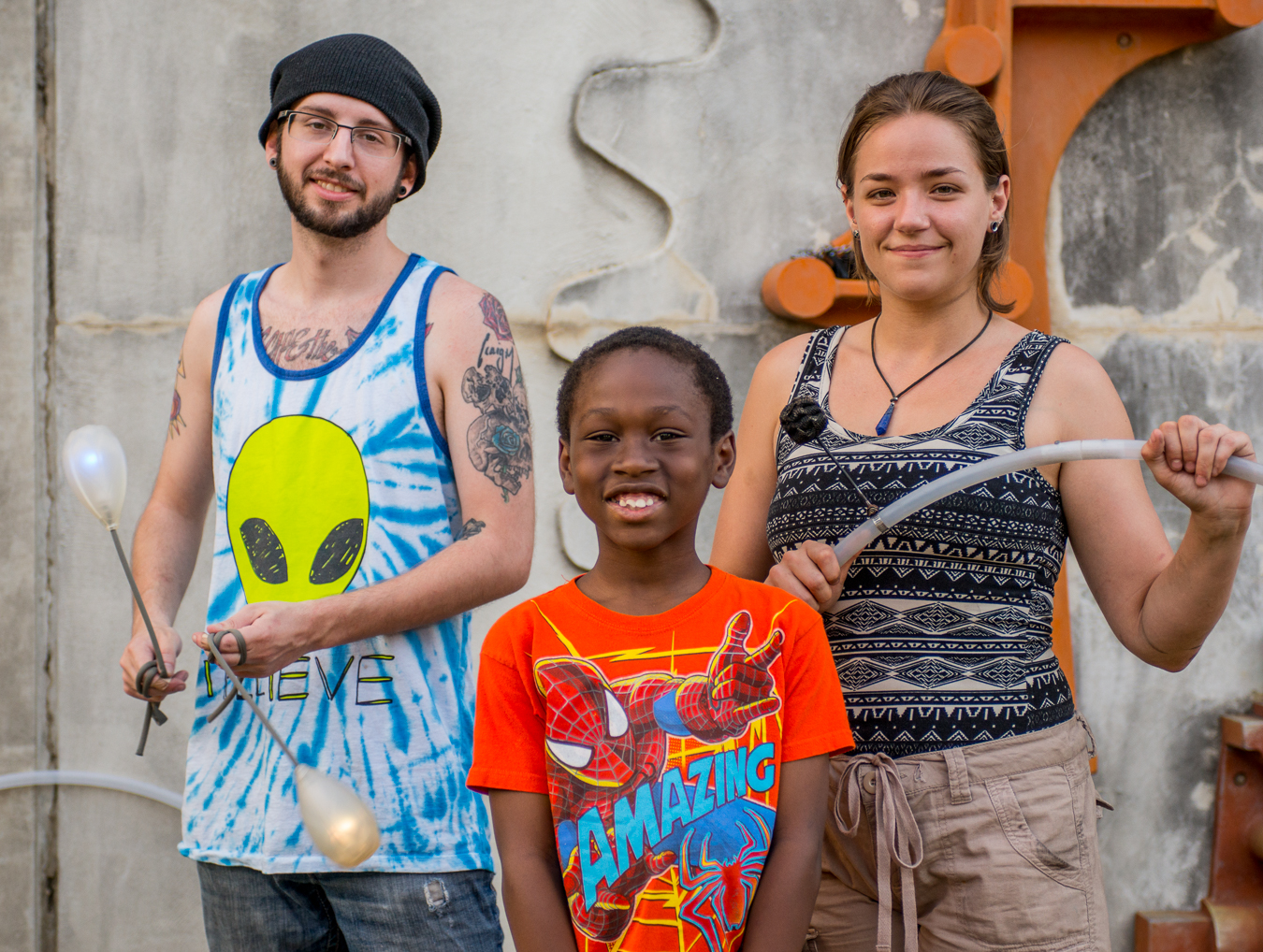 Ryan and Korin, the fire spinners along with a young spectator who wanted his photo taken.