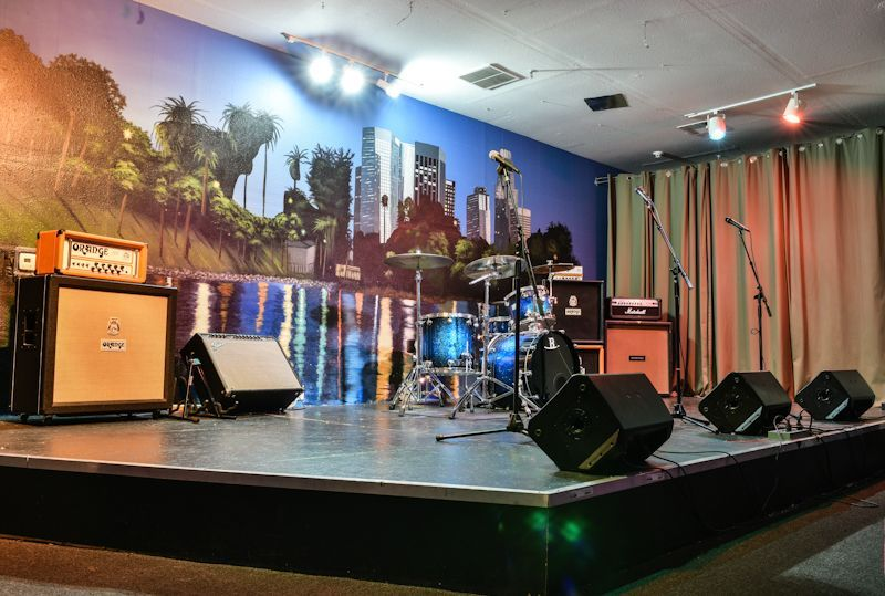 ROOM G  is a traditional showcase room with a stage and a front row seat for important people.