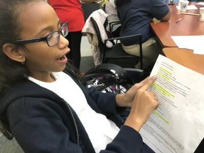 """An FYI student shares a poem """"Child of the Americas,"""" by Latina poet Aurora Levins Morales during a self identity project."""