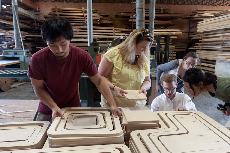 photo by Kye Liang: field trip to Walter Furman Co. in Fall River. Checking our plywood pieces.