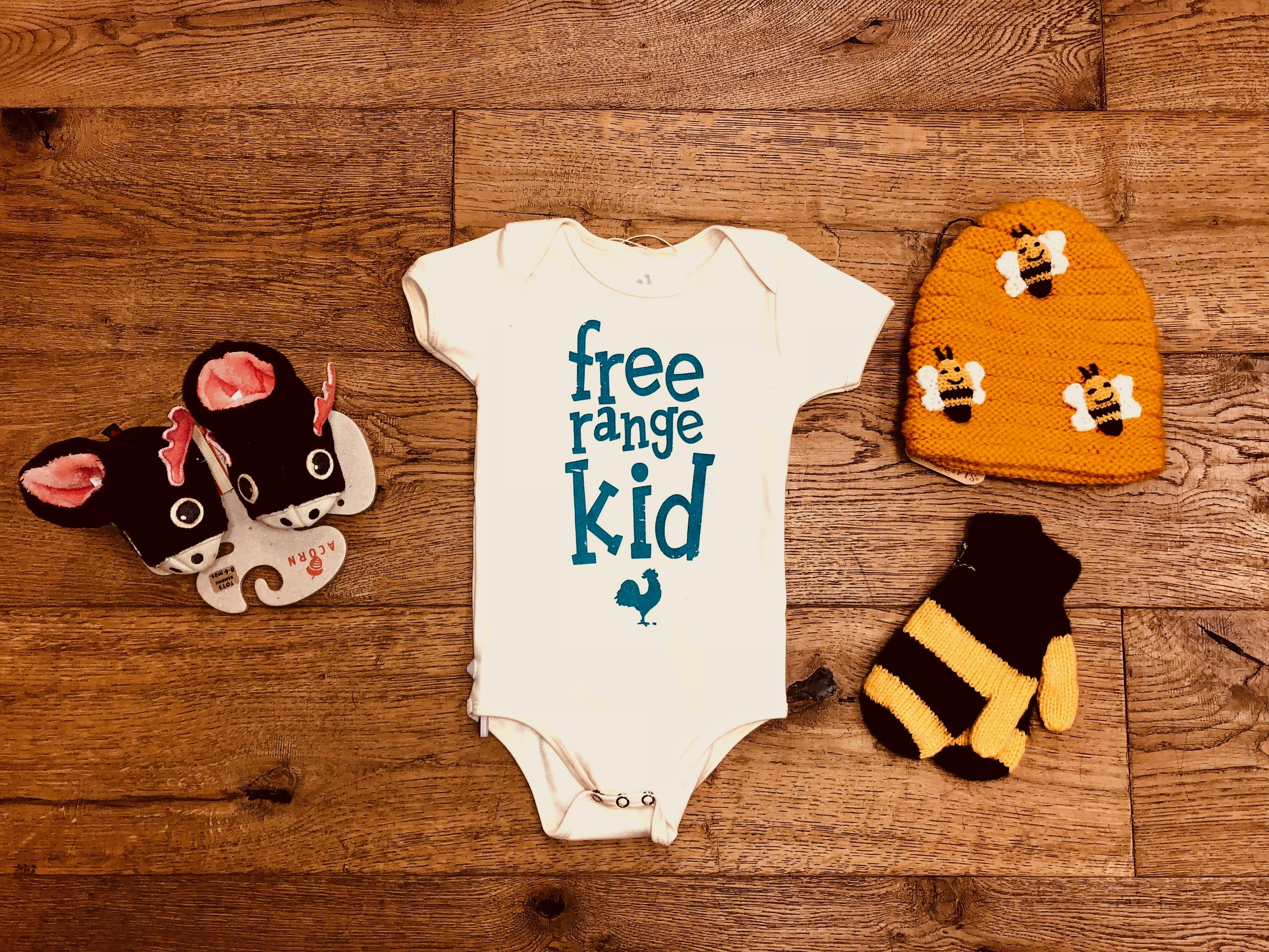 WONDER  - For the cute babes in your life we have onesies from Locally Grown, animal slippers from Acorn and fun winter accessories from Andes Gifts.