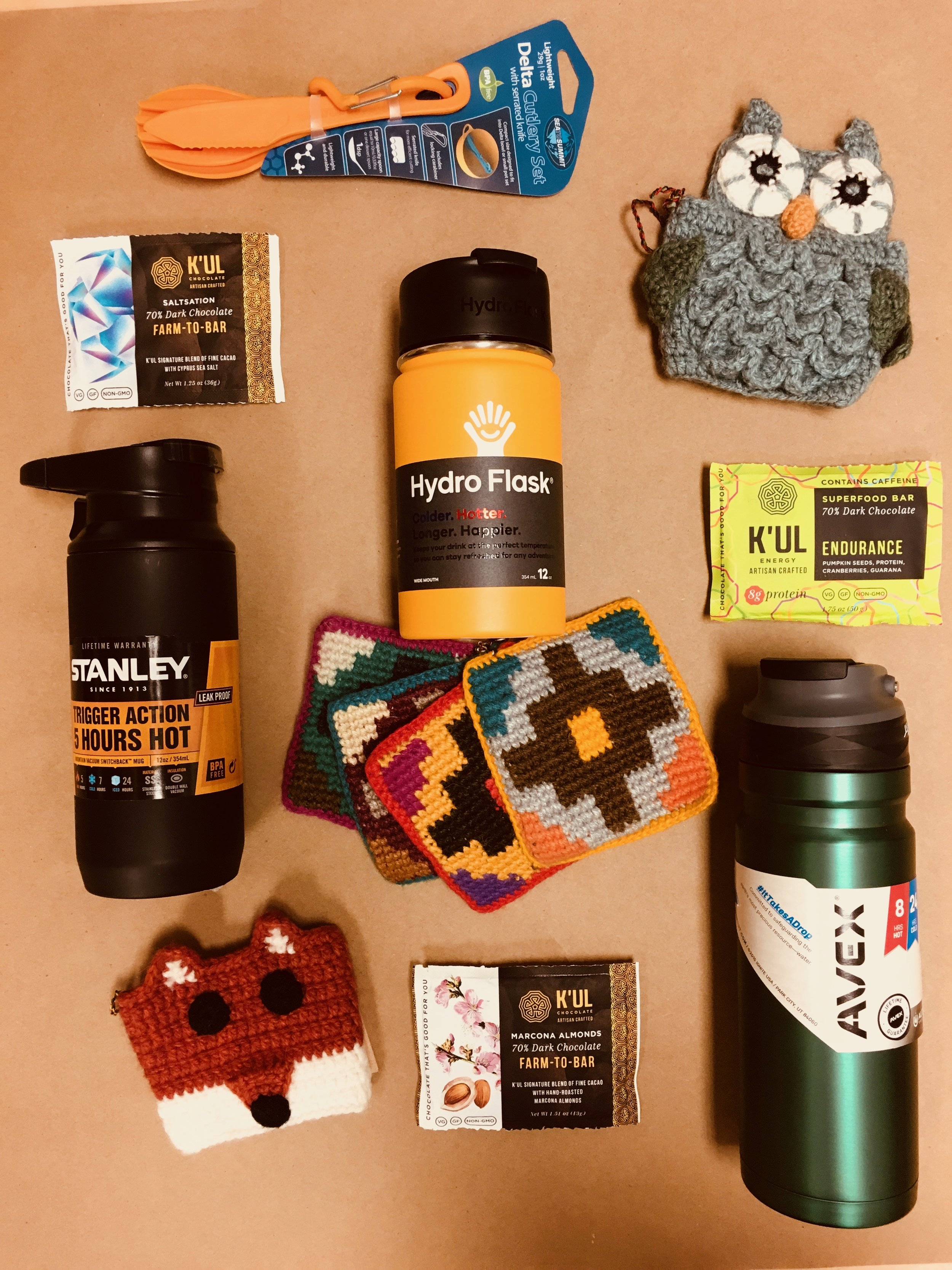STOCK THE STOCKING -For the coffee and hot chocolate lovers in your life thermoses from Stanley, Avex, and Hydroflask make a great gift with some delicious dark chocolate from K'ul. Top your gift off with Andes animal cozies!