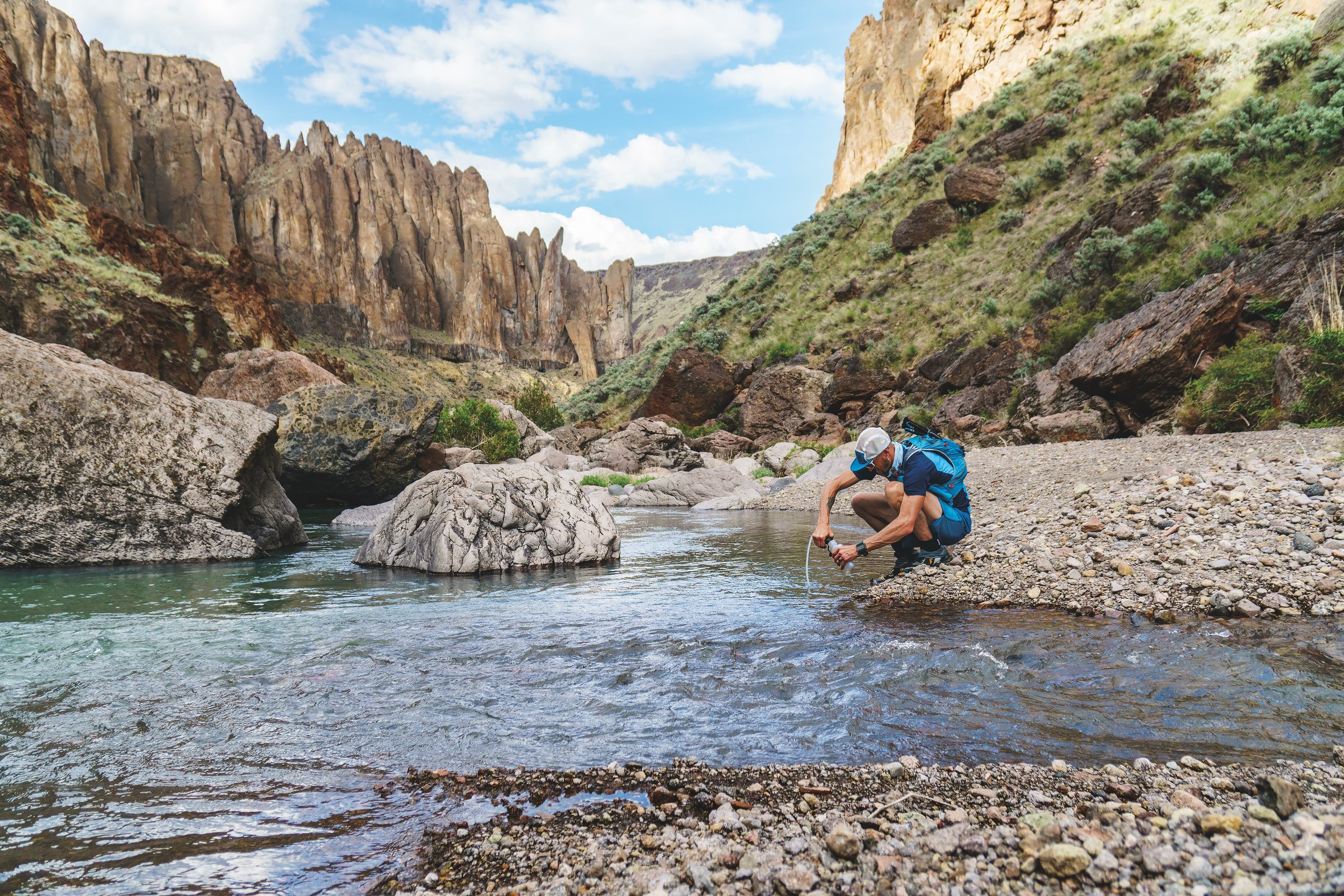 """""""Jeff Browning bellies up to the bar at the local watering hole. Owyhee Canyonlands, Oregon."""" Photo credit to Fredrik Marmsater."""