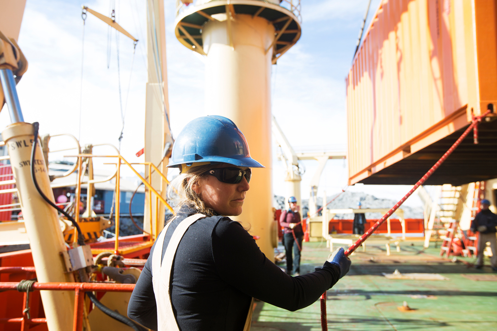 Julia Carleton assists with cargo operations aboard the Laurence M. Gould at Palmer Station.