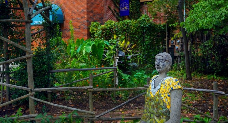 The gardens and mill woman statue outside Townsend Bertram & Company.