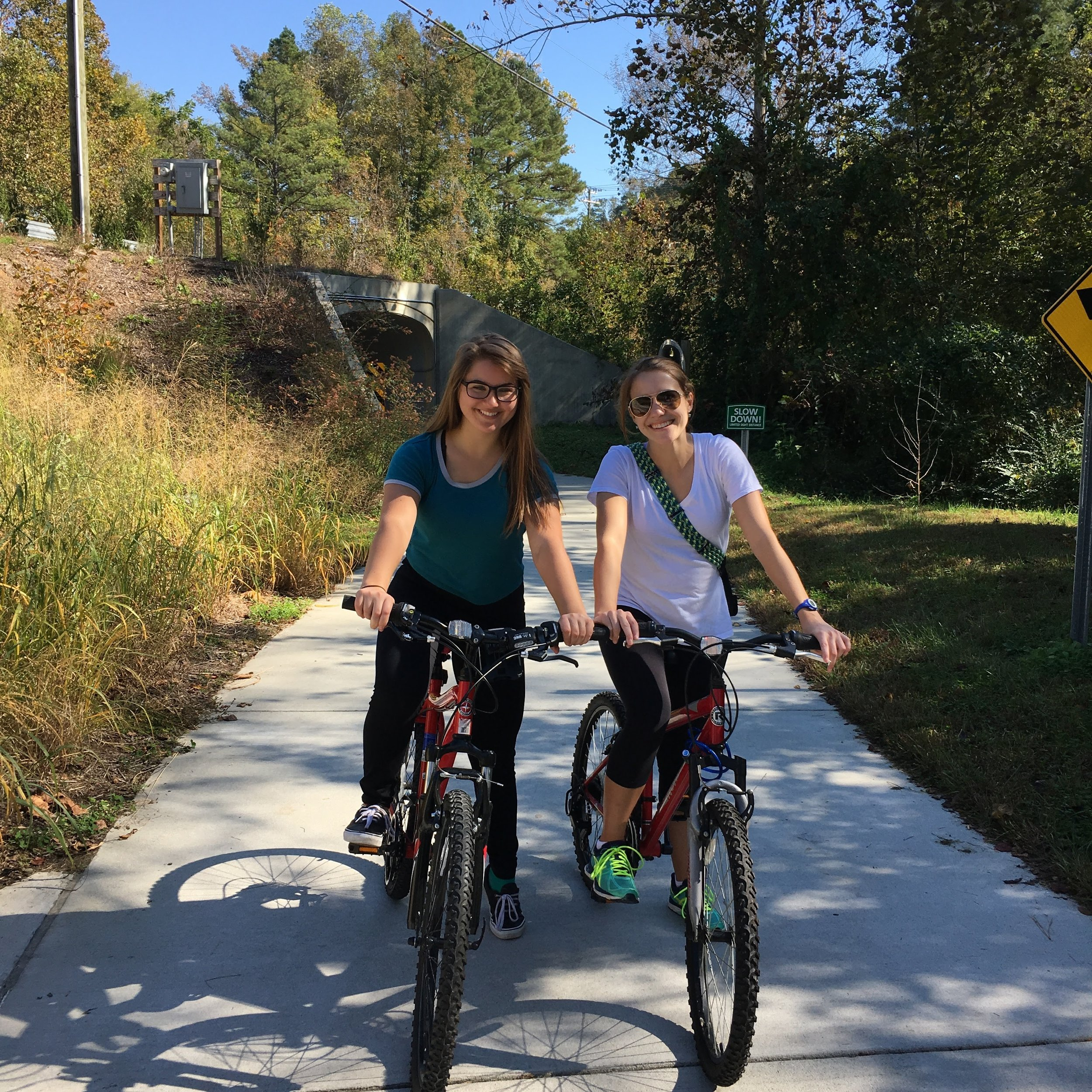 Getting a bike has not only allowed me to decrease my carbon footprint and save money, but I get to bask in the sun, spend quality time with good friends like Katie (right) and get a workout in, all of which increase serotonin levels. This trail is on Obie Creek towards Southern Village.