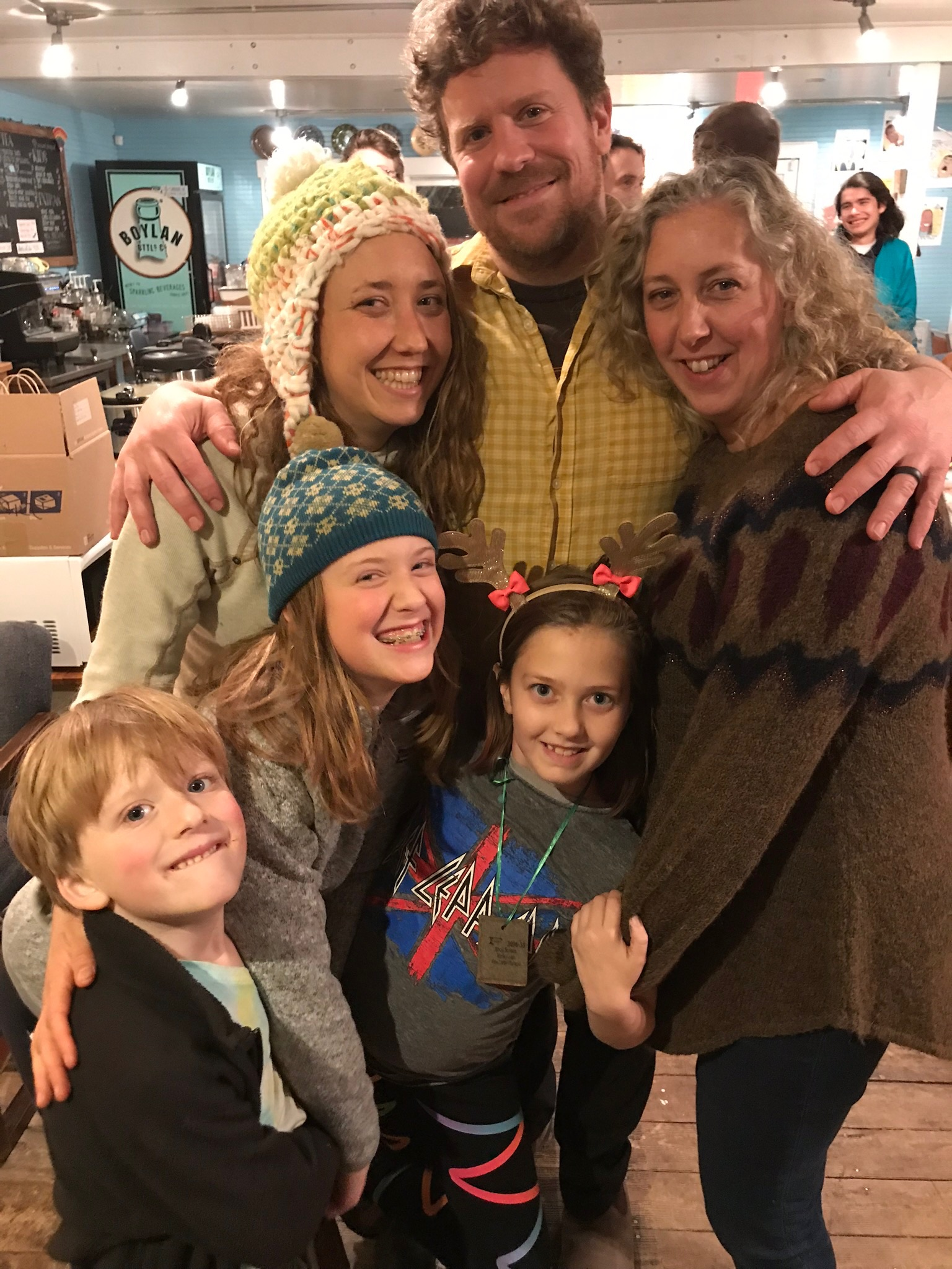 TB&C is a true family business. In this photo Betsy Bertram, Taylor Dansby, and Sara Abernethy embrace in a group hug with Isla, Rowan and Louis at our holiday staff celebration at Johnny's.