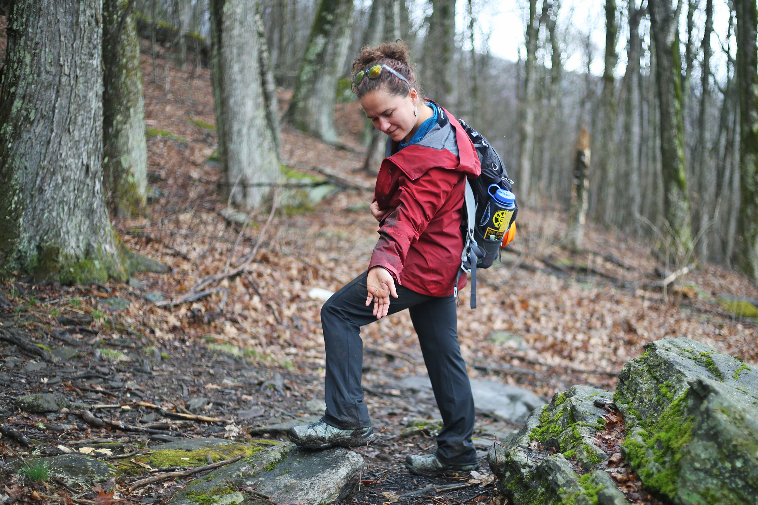Assessing the amount of mud that has accumulated on every article of clothing after slipping and sliding down the steep section of Woody Ridge.