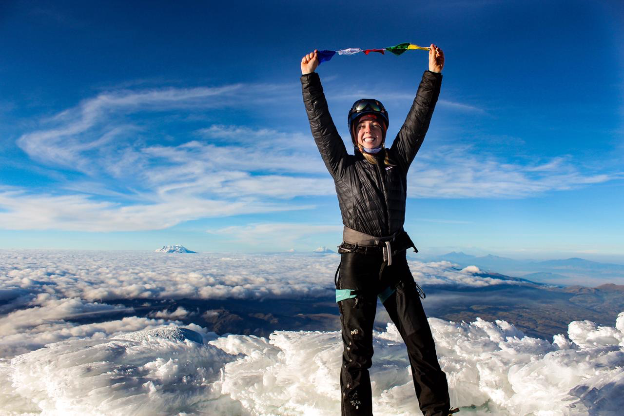 Avery at the summit of Cayambe