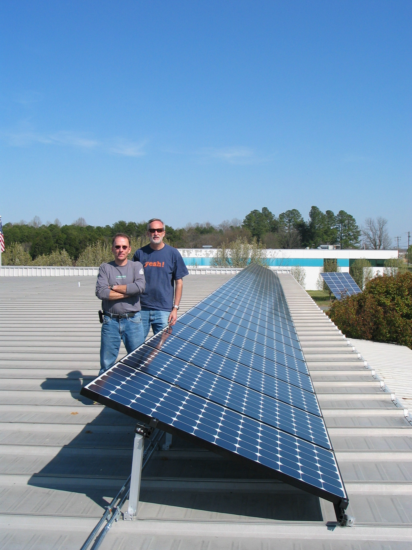 Tom and Eric with roof array.jpg