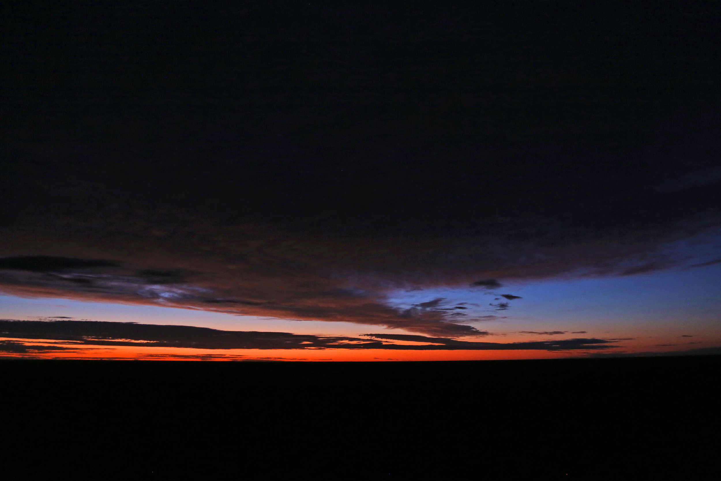 The final light of the day casts an ephemeral glow across the horizon.