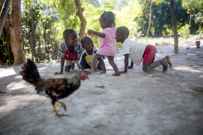 Miloutchina plays with neighborhood boys.